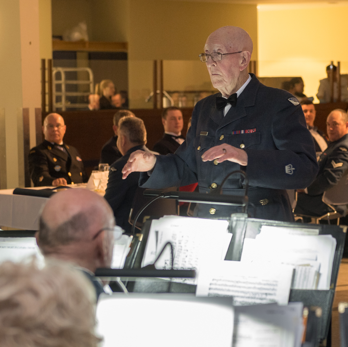 Chief Warrant Officer (retired) Erle Dolsen steps into a familiar role during a mess dinner on March 28, 2018. He served as the 14 Wing Greenwood Bands' bandmaster for 10 years, more than four decades ago. PHOTO: Leading Seaman Louis-Philippe Dubé, GD01-2018-0129-028