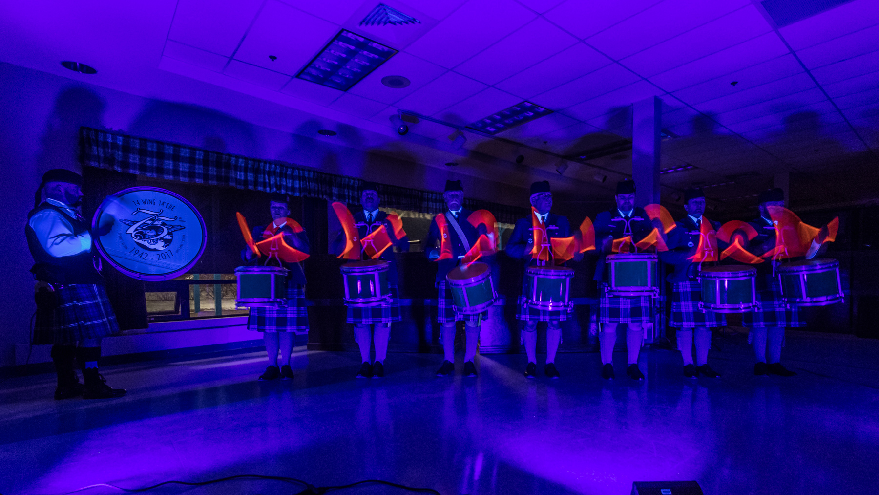 Members of the 14 Wing Bands present a black light drum line show on March 28, 2018, during the wing's annual RCAF mess dinner. PHOTO: Leading Seaman Louis-Philippe Dubé, GD01-2018-0129-039