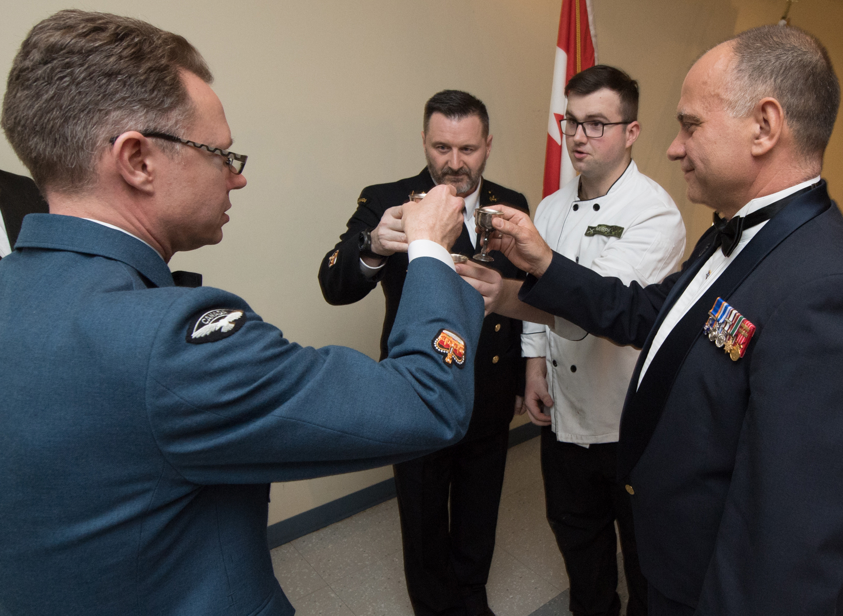 14 Wing Greenwood Wing Chief Warrant Officer Luc Emond (right) toasts with the mess dinner staff—Warrant Officer Jeff Campbell (left), Petty Officer 1st Class Rod Belanger (left centre) and Private Justin Murphy—at 14 Wing's mess dinner on March 28, 2018. PHOTO: Leading Seaman Louis-Philippe Dubé, GD01-2018-0129-043