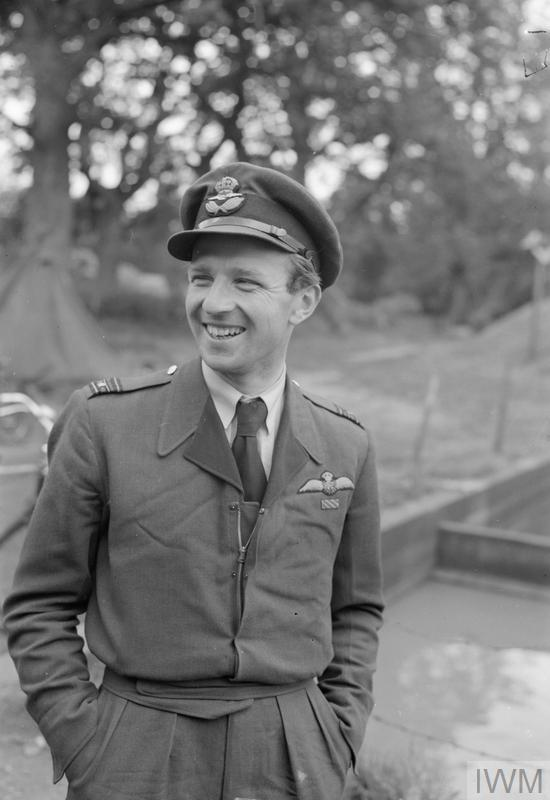 "Squadron Leader Percy Belgrave ""Laddie"" Lucas looks sharp in his custom-zippered battle dress as commander of 616 Squadron in the summer of 1943 at RAF Ibsley, Hampshire. A former international golfer and journalist, Lucas opened his victory score with No. 249 Squadron RAF in Malta, a unit which he later commanded. He commanded 616 Squadron from April to July 1943, following which he led the Coltishall Wing. After a further rest from operations he commanded No. 613 Squadron RAF, flying night-intruder sorties until the end of the war. PHOTO: Imperial War Museum, CH10315"