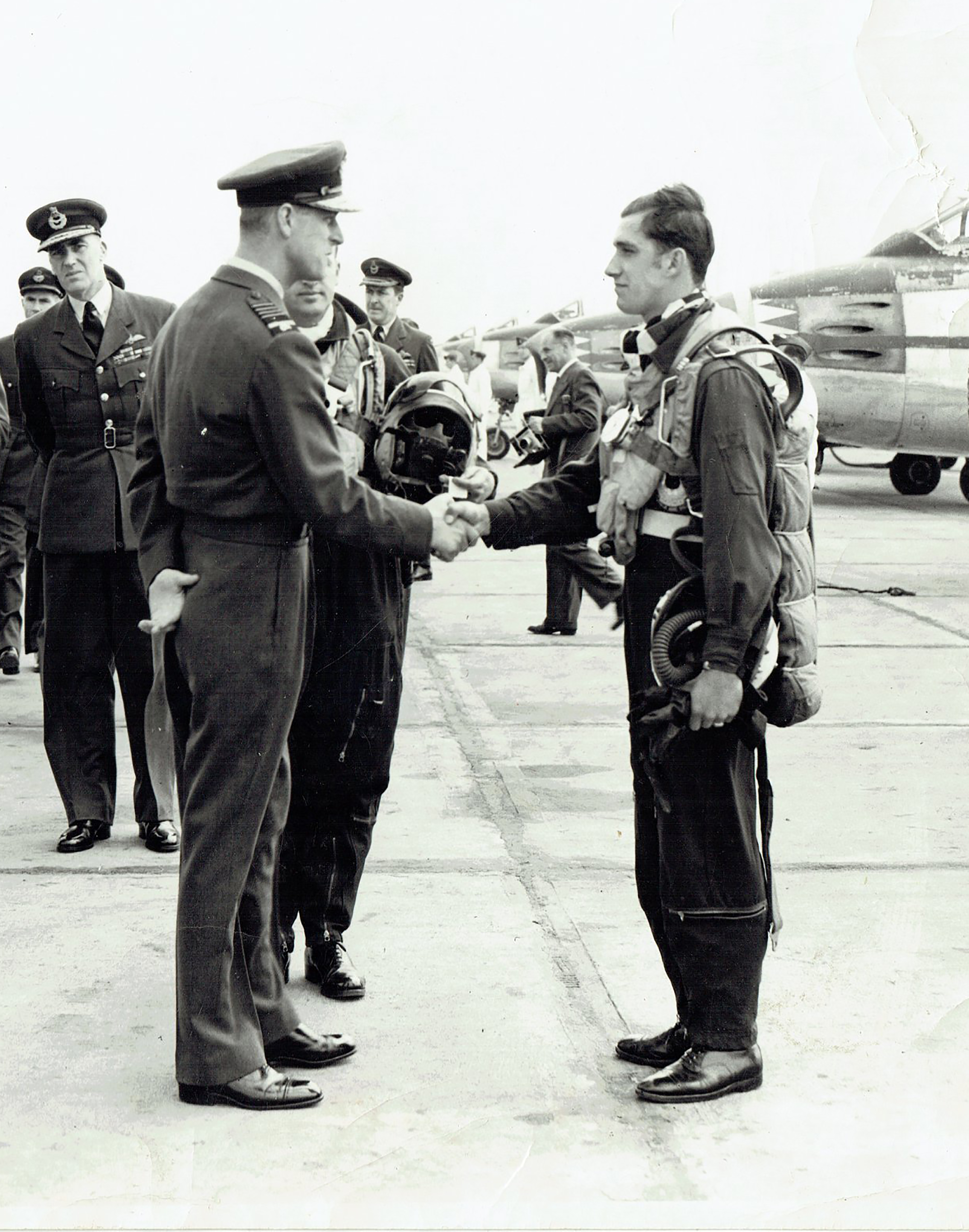 Young RCAF pilot Ralph Annis is congratulated by Prince Philip after an impressive aerobatic display with 441 Squadron in 1953 or '54. PHOTO:  https://www.facebook.com/groups/3wing/?ref=direct