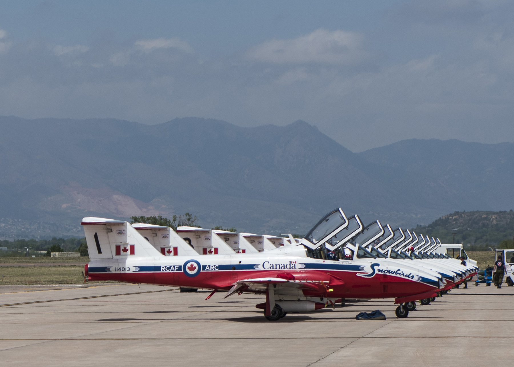 On the flight line at Peterson Air Force Base, Colorado, the Canadian Forces Snowbirds aerial demonstration team is ready to fly its part during the 60th anniversary celebration of the North American Aerospace Defense Command (NORAD) on May 12, 2018. PHOTO: U.S. DoD, Staff Sergeant Emily Kenney
