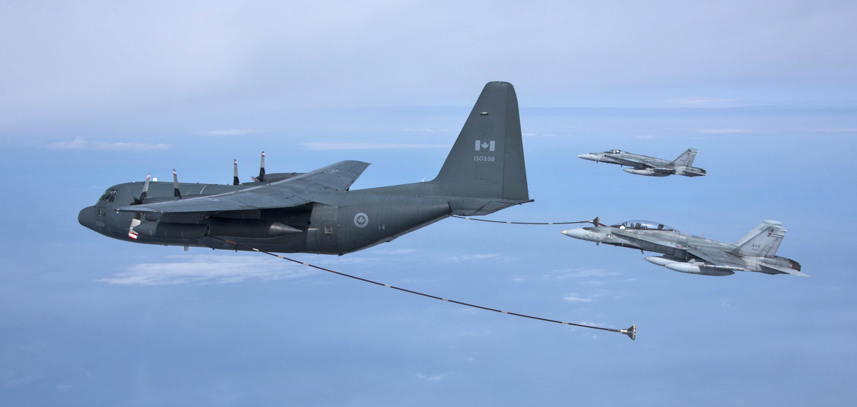 A CC-130HT Hercules aircraft from 435 Squadron refuels two CF-188 Hornets from 409 Tactical Fighter Squadron on May 26, 2015, while enroute to Inuvik, Northwest Territories for Exercise Amalgam Dart. PHOTO: Corporal Arthur Ark, AE02-2015-0118-001