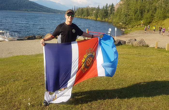 A man holds a flag.