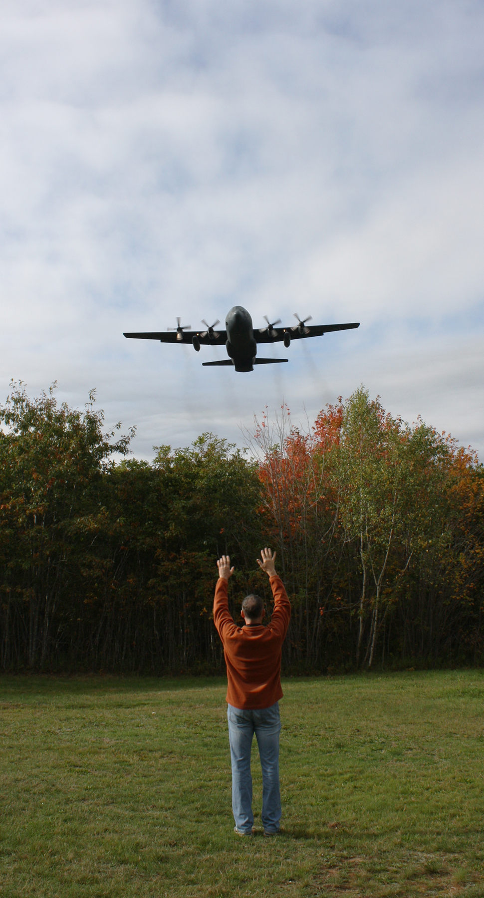 As the only mobile victim after a simulated two-aircraft crash, Master Corporal Wayne Wilson signals to a 413 Transport and Rescue Squadron CC-130 Hercules on October 5, 2018, during the squadron's week-long search and rescue exercise. PHOTO: Sara White