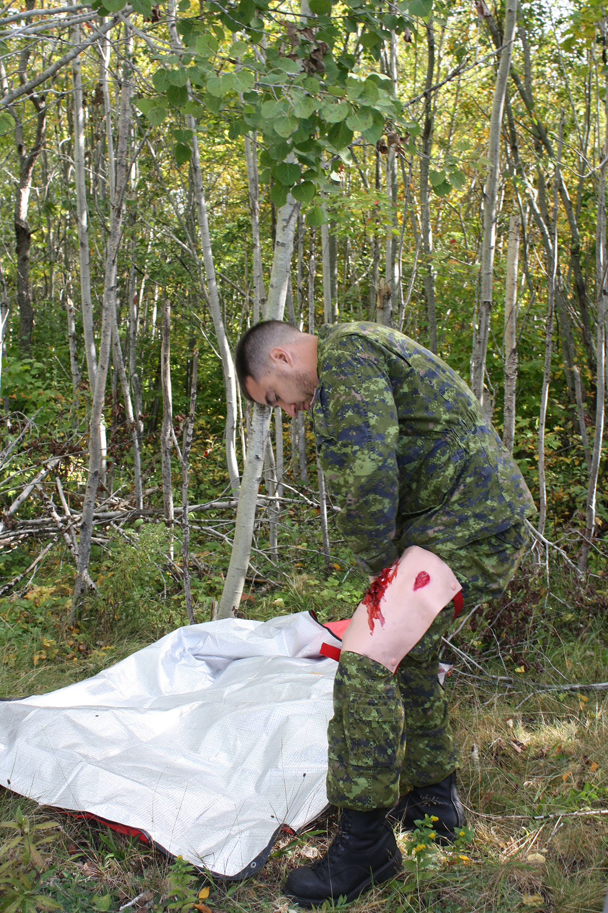 Volunteer victim Corporal Jean-Luc Germain ensures his simulated puncture wound is in place as the mass casualty exercise for 413 Transport and Rescue Squadron's search and rescue exercise gets underway on October 5, 2018. PHOTO: Sara White