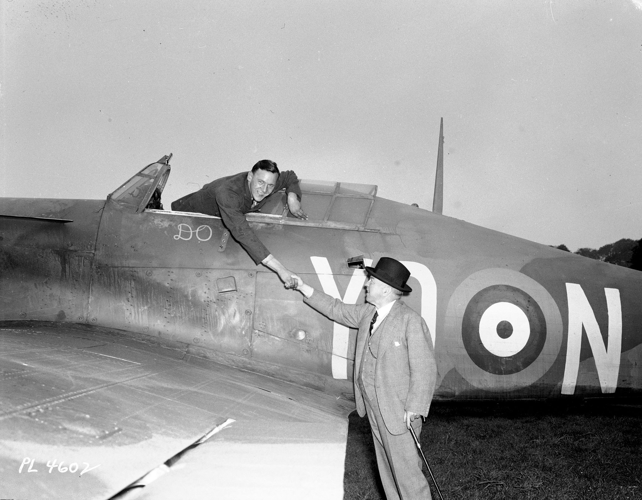 "On September 10, 1941, ""somewhere"" in England, Canadian Prime Minister Mackenzie King shakes hands with Royal Canadian Air Force 401 Squadron's Leading Aircraftman Walter Kornack, an aircraft maintainer from Verdun, Québec, over the wing of a Hurricane fighter aircraft. PHOTO: DND Archives, PL-4602"
