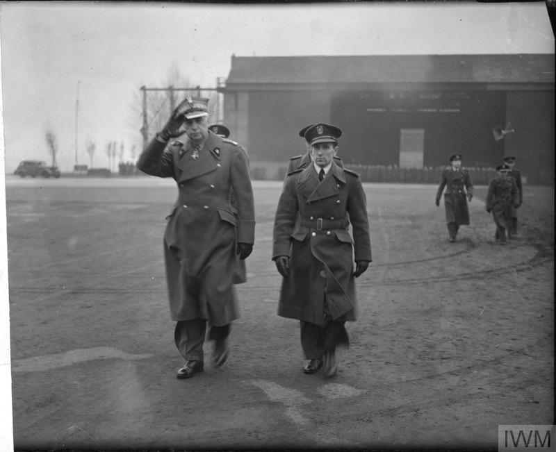 "General Kazimierz Sosnkowski (left), the commander-in-chief of the Polish Armed Forces, accompanied by Squadron Leader Zdzisław Krasnodębski, at RAF Northolt, United Kingdom, on February 24, 1944. The ""Spirit of Ostra Brama"", a C-47 (DC-3) Dakota being repatriated from Winnipeg, Manitoba, to Poland in March 2019, was used as General Sosnkowski's personal transport. PHOTO: Imperial War Museum, HU 128282"