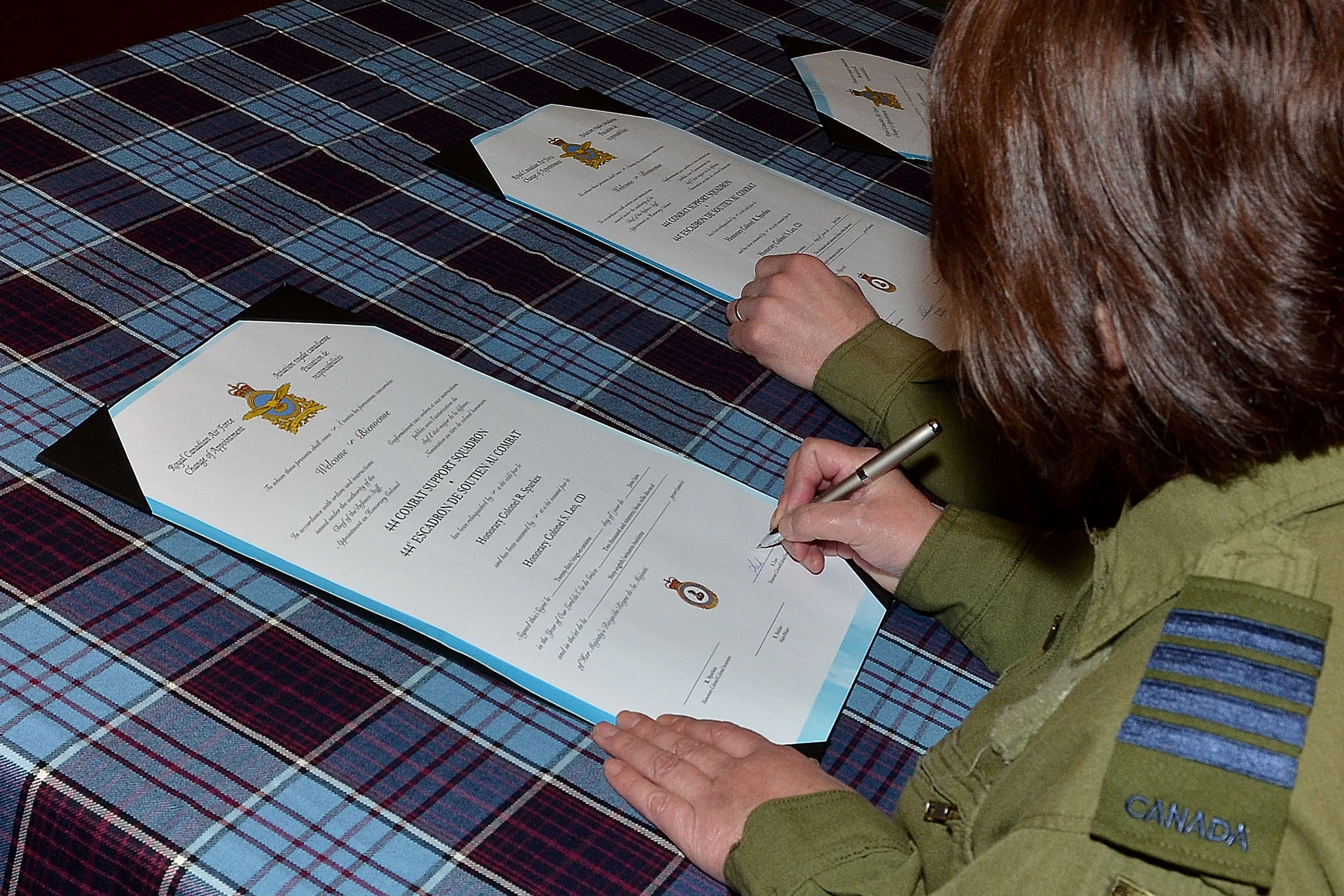 On June 21, 2109, Honorary Colonel Sarah Leo signs the document appointing her as honorary colonel of 444 Combat Support Squadron, located at 5 Wing Goose Bay, Newfoundland and Labrador. She is the first indigenous woman to be appointed to the post at the squadron. PHOTO: Master Corporal Krista Blizzard, GB2019-06-172