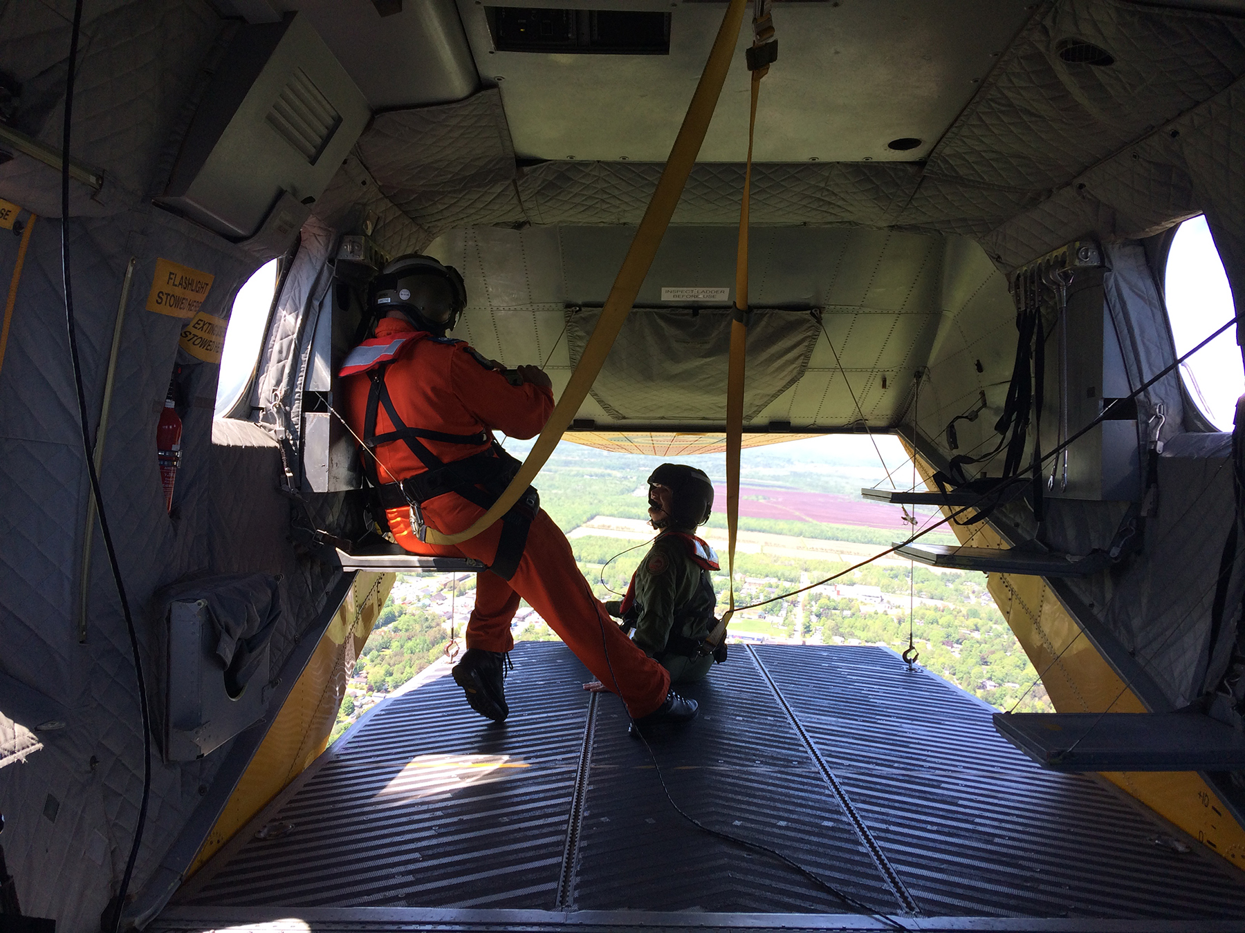 """They let me fly sitting on that ramp part, with my feet hanging out!"" said Sandra Snow, Honorary Colonel of 14 Wing Greenwood's 415 (Long Range Patrol Force Development) Squadron, and Mayor of Kentville, Nova Scotia, about her June 12, 2019, flight in a 413 (Transport and Rescue) Squadron CH-149 Cormorant helicopter – and Search and rescue technician Master Warrant Officer Chris Lamothe photographed the moment. PHOTO: Sara White"