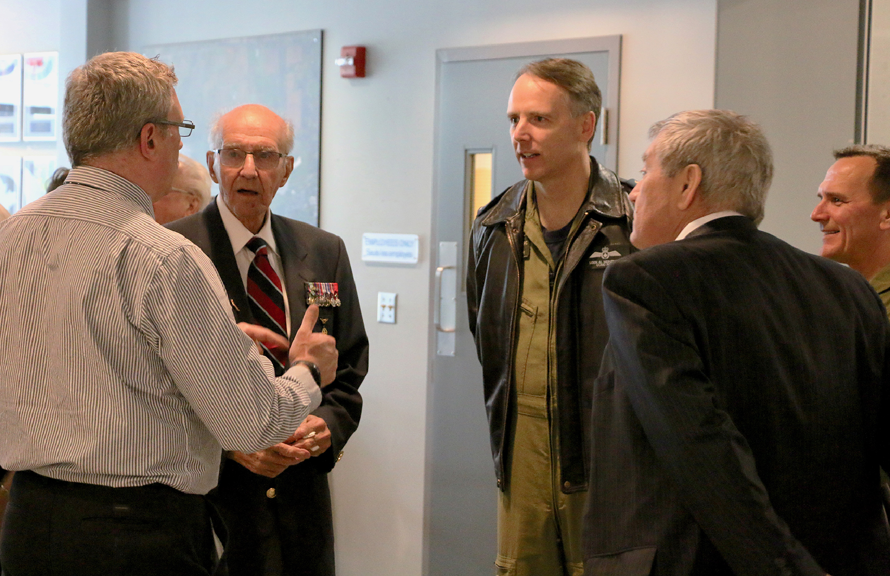 National Air Force Museum of Canada's executive director Kevin Windsor greets Flight Lieutenant (retired) Stuart Vallières and RCAF commander Lieutenant-General Al Meinzinger on May 15, 2019. PHOTO: Makala Chapman
