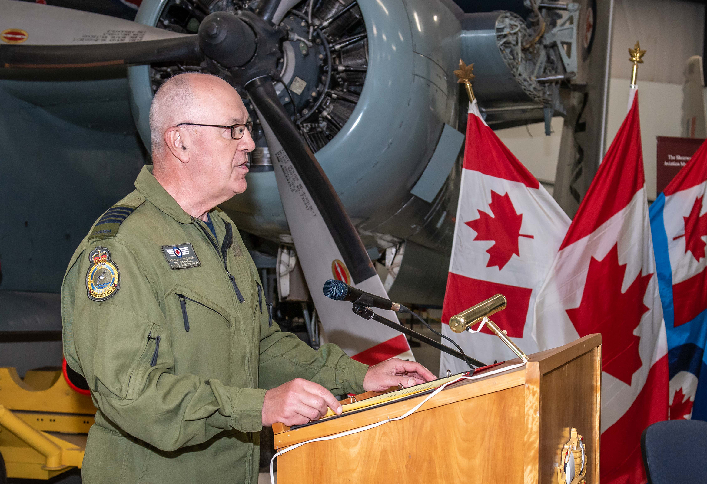 At the Shearwater Aviation Museum at 12 Wing in Nova Scotia, outgoing Honorary Colonel Tom Birchall addresses the audience at the change of appointment ceremony held on June 24, 2019. PHOTO: PHOTO: Master Corporal Anthony Laviollette, SW04-2019-0257-003