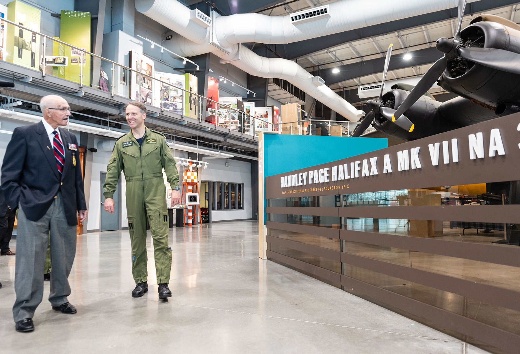 On May 15, 2019, Flight Lieutenant (retired) Stuart Vallières views the signage for the Handley Page Halifax heavy bomber at the National Air Force Museum of Canada in Trenton, Ontario, as commander of the Royal Canadian Air Force Lieutenant-General Al Meinzinger looks on. PHOTO: Makala Chapman