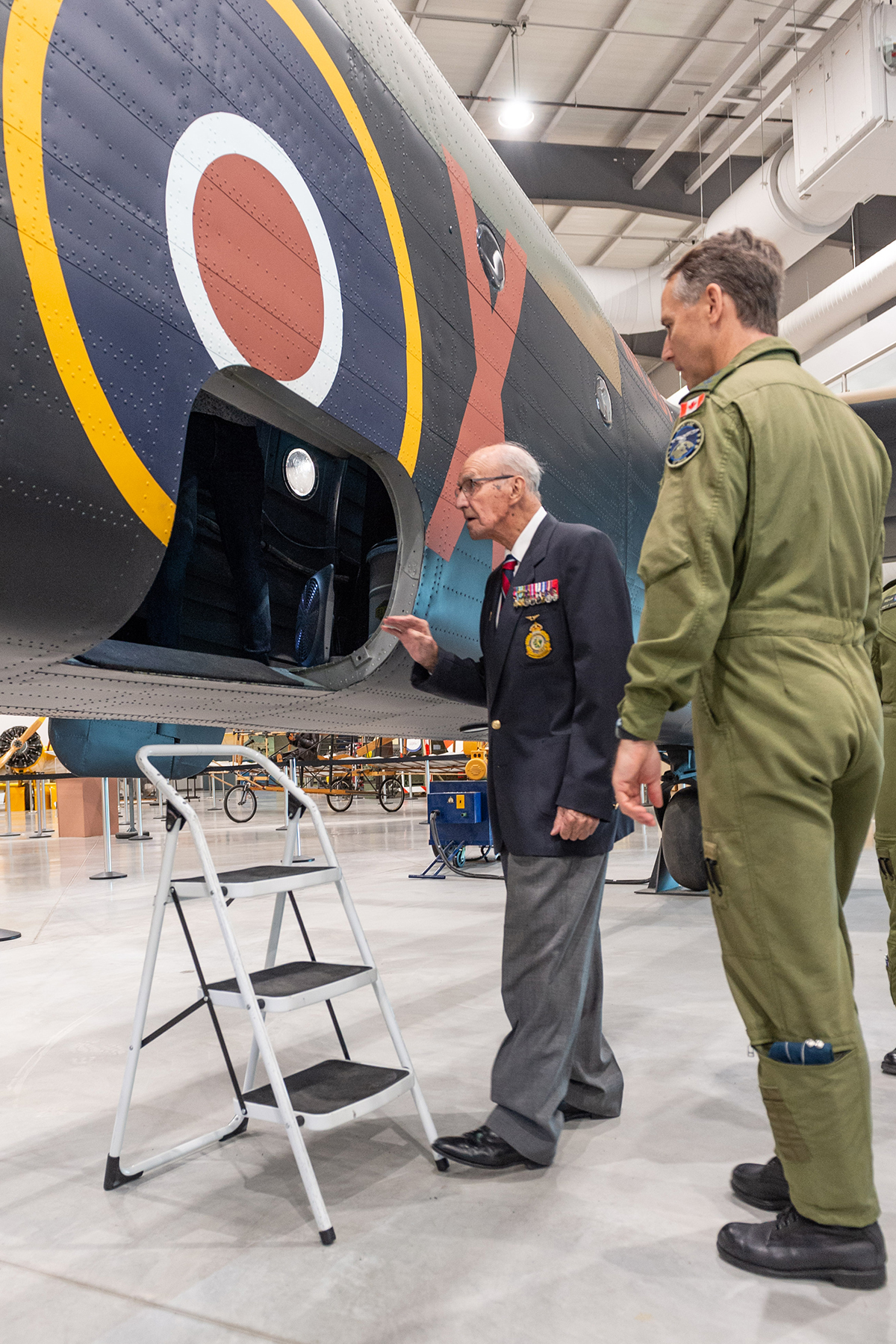 Flight Lieutenant (retired) Stuart Vallières and Lieutenant-General Al Meinzinger, commander of the Royal Canadian Air Force, look into the belly of the Handley Page Halifax bomber at the National Air Force Museum of Canada in Trenton, Ontario, on May 15, 2019. PHOTO: Ken Beliwicz, TN12-2019-0119-001-007