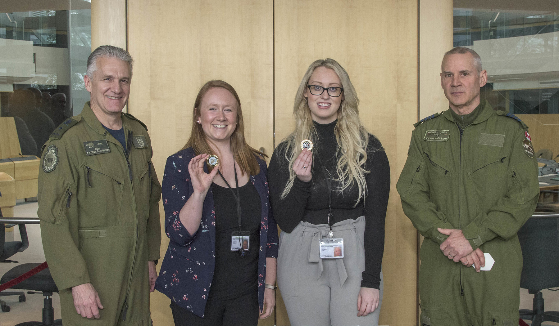 Jeanne Yurris (centre, left) and Savannah Lane, public affairs and communications interns, stand with Brigadier-General Patrick Carpentier (left) and Honorary Colonel Kevin McLeod after receiving Joint Task Force (North) coins during the honorary colonels conference hosted by Joint Task Force (North) on May 29, 2019, in Yellowknife, Northwest Territories. PHOTO: Captain Soomin Kim