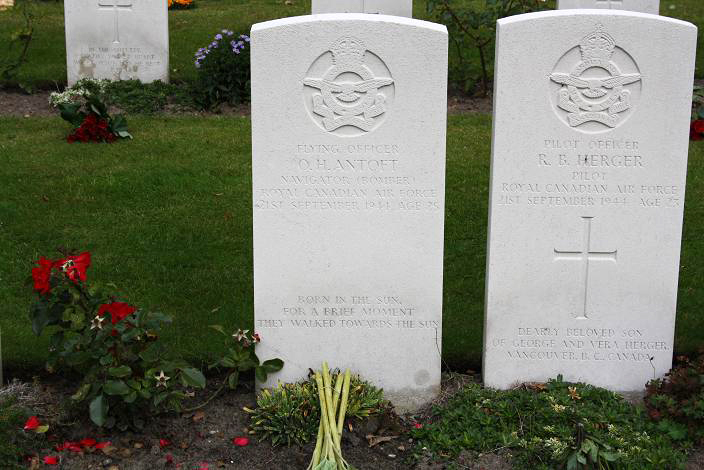 Two gravestones, side by side, each with an RCAF badge engraved near the top.