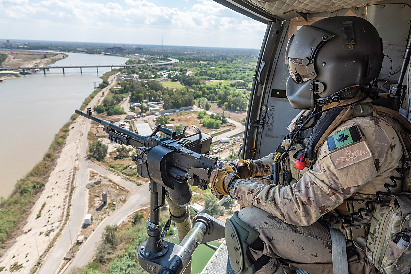 When a Chinook helicopter conducted a medical evacuation in Mali, two Griffon helicopters flew alongside as armed escorts. PHOTO: Master Corporal Bryan Carter, KW11-2019-0073-092