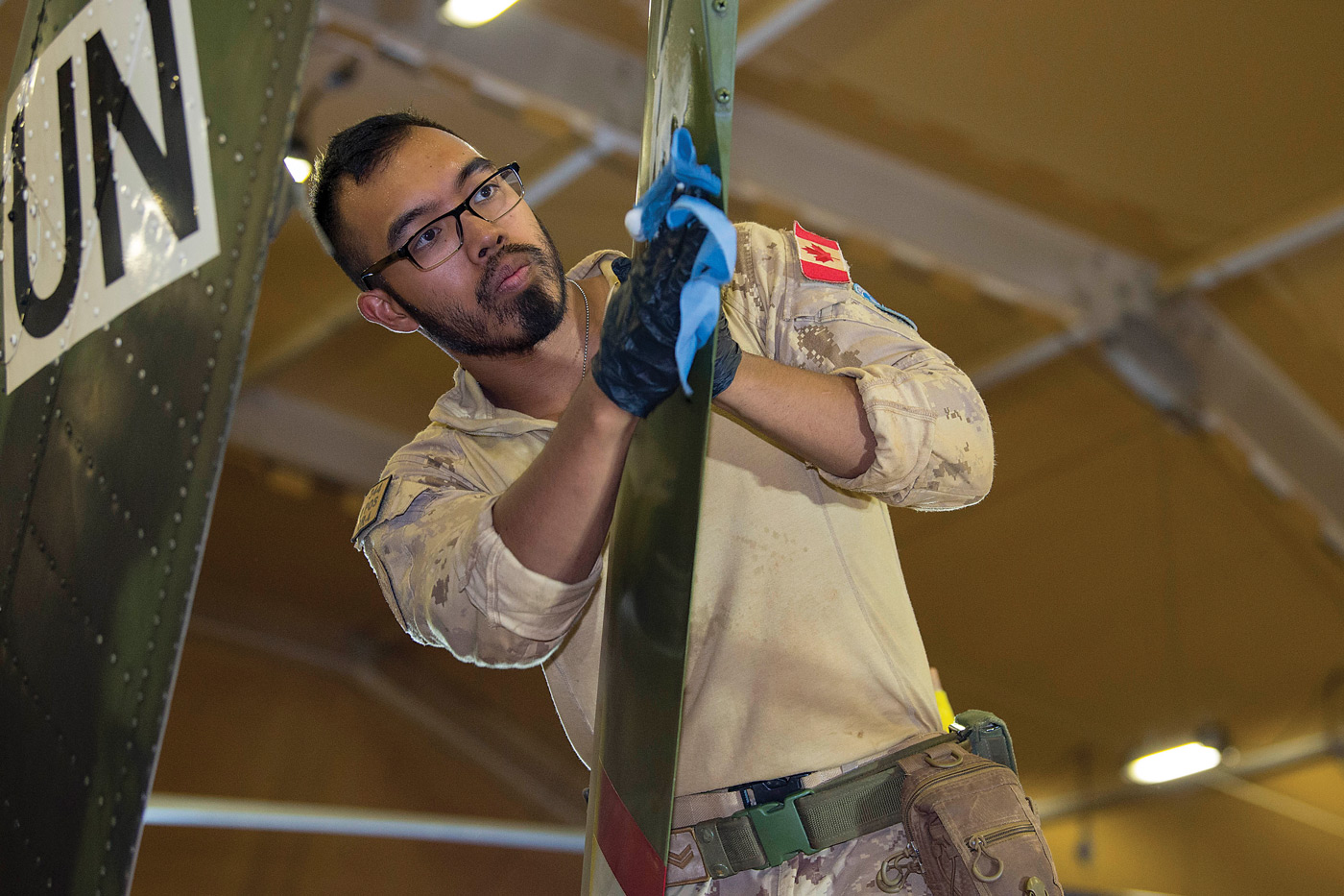 The tail rotor of a CH-146 Griffon is cleaned as part of regular maintenance during Operation Presence. PHOTO: Corporal François Charest, TM02-2019-0071-0003