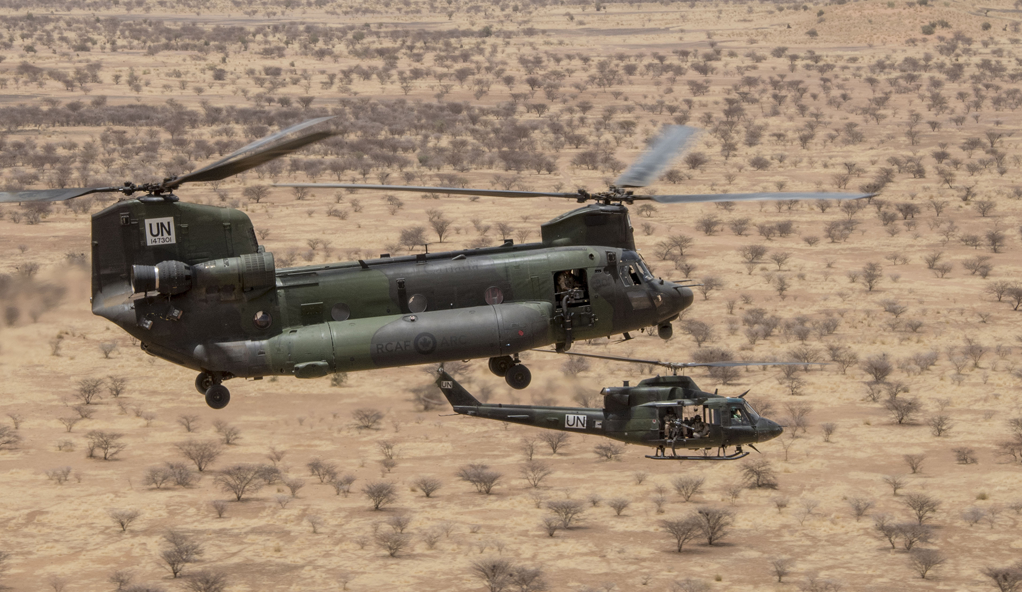 A CH-146 Griffon helicopter and a CH-147F Chinook helicopter fly in formation following an aeromedical evacuation exercise in June 2019 during Operation Presence. PHOTO: Corporal François Charest, TM02-2019-0074-0037