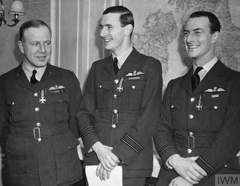 "Squadron Leader Ronald Kellett, Canadian Squadron Leader John A. Kent, nicknamed ""Kentowski"" by the Polish airmen he commanded, and Squadron Leader Athol Forbes, all former commanding officers of No. 303 Polish Fighter Squadron, after being decorated with the Virtuti Militari by General Władysław Sikorski at the Hotel Rubens in London on December 24, 1940. PHOTO: © Imperial War Museum, HU 128190"