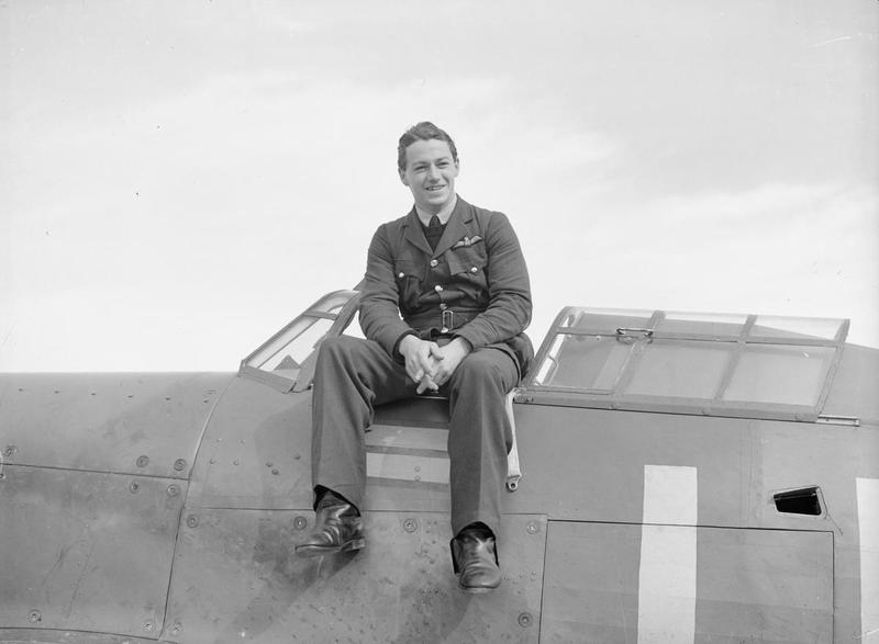 "Flying Officer Hugh Tamblyn of No. 242 ""Canadian"" Squadron, photographed sitting on Squadron Leader Douglas Bader's Hurricane at Duxford, England in late September 1940 during the Battle of Britain. PHOTO: Imperial War Museum, CH 1410"