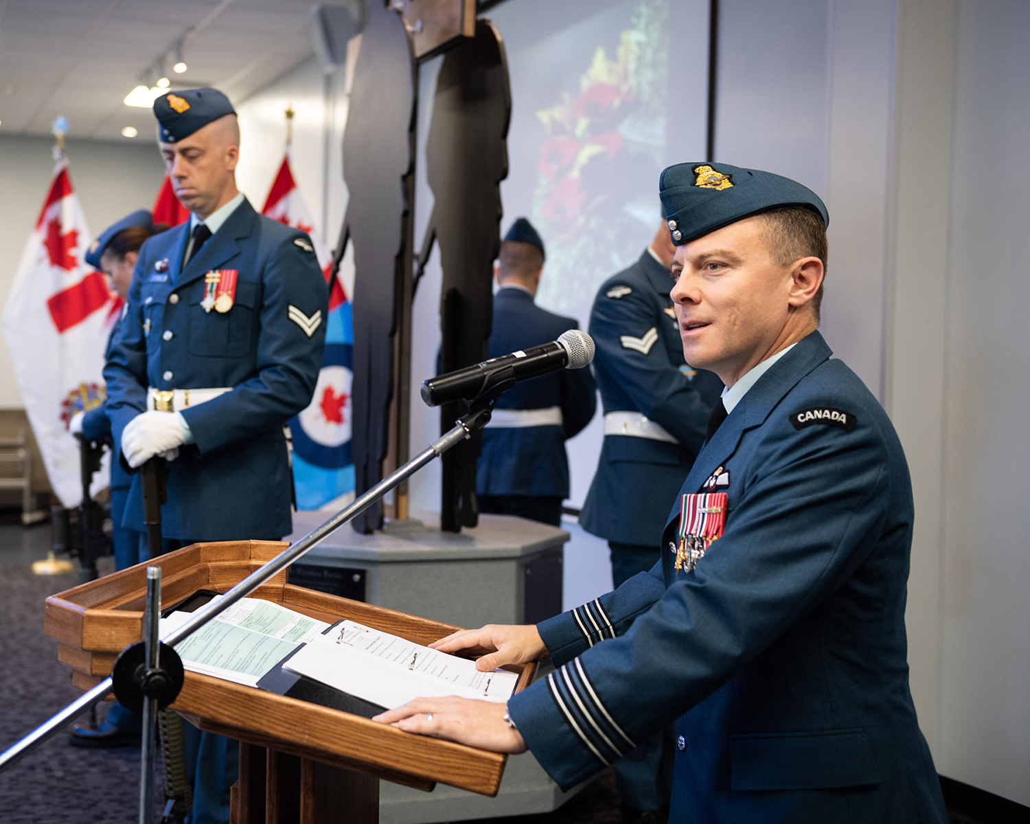 On September 15, 2019, Lieutenant-Colonel Jody Edmonstone, commanding officer of 425 Tactical Fighter Squadron, 3 Wing Bagotville, Québec, addresses the attendees of the ceremony held in remembrance of the Battle of Britain in Bagotville, Québec. PHOTO: Corporal Dominic Duchesne-Beaulieu, BN06-2019-0487-010