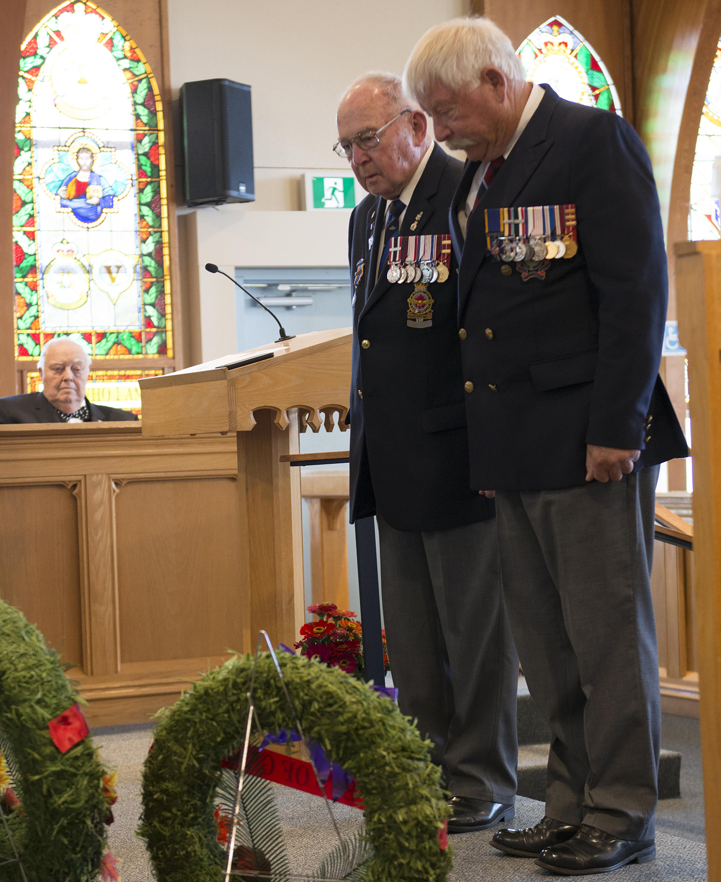 Veterans pause in remembrance on September 15, 2019, after laying a wreath during the 19 Wing Comox, British Columbia, ceremony marking the 79th anniversary of the Battle of Britain, held in the wing chapel. PHOTO: Sergeant Andrew Davis, CX03-2019-0331-016