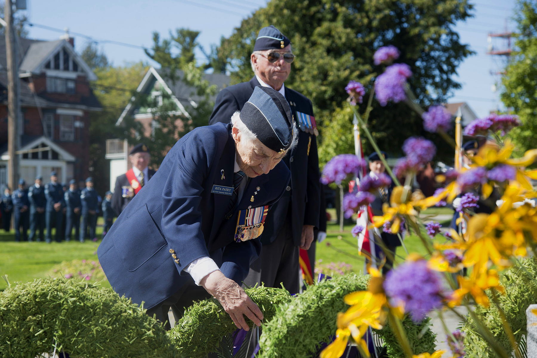 On September 15, 2019, veteran Rita Patry of 422 Squadron places a wreath at the Branch 23 Royal Canadian Legion cenotaph. Each year, members of 22 Wing/Canadian Forces Base North Bay, Ontario, hold a ceremony remembering the Battle of Britain, fought during the Second World War, in which Canadian pilots and their allies defended England against the German enemy. PHOTO: Corporal Rob Ouellette, NB01-2019-217-11