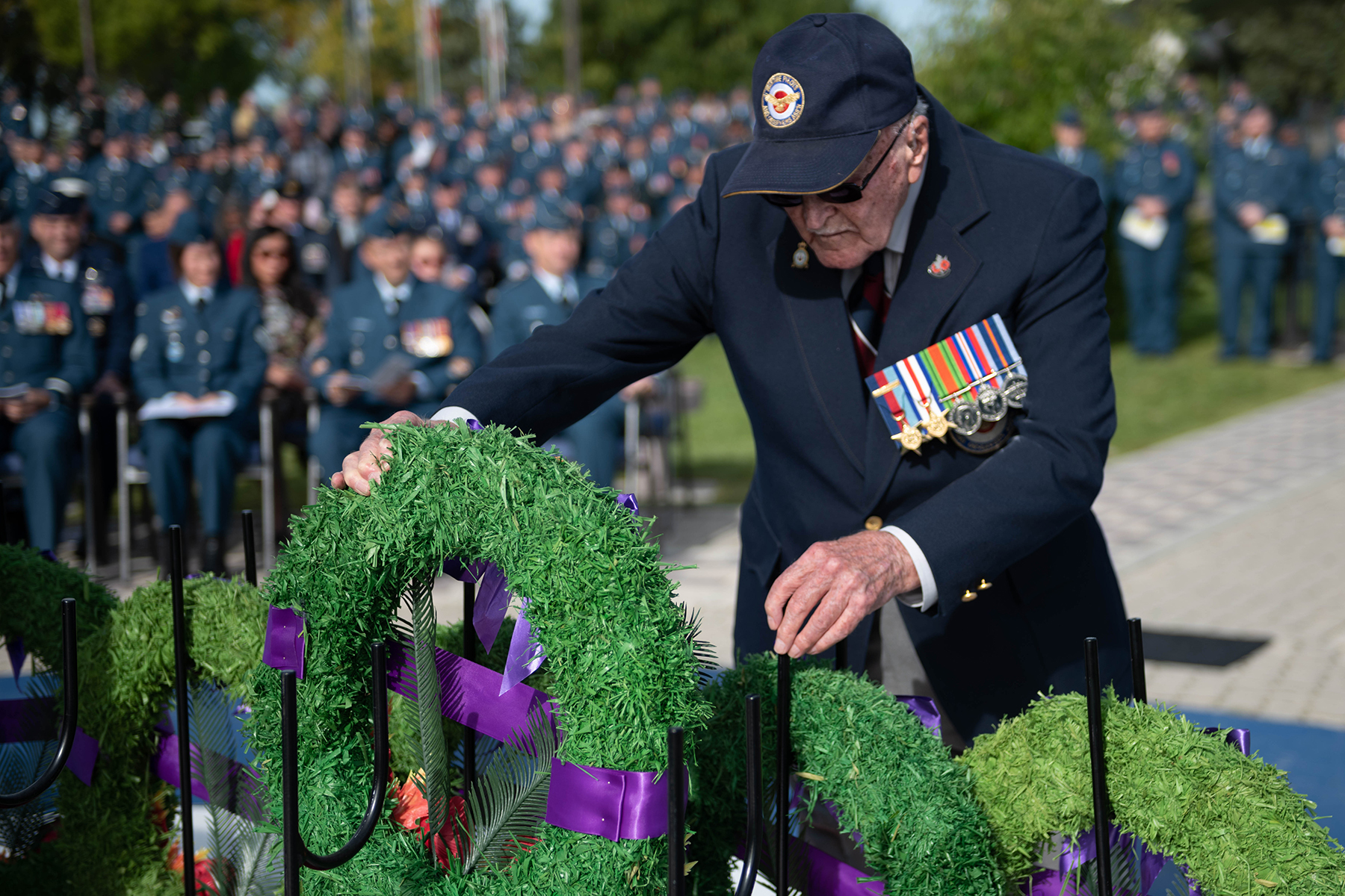 Flying Officer (retired) Ralph Wild lays a wreath on behalf of survivors of the Battle of Britain on September 15, 2019, during the 17 Wing Winnipeg, Manitoba, Battle of Britain remembrance ceremony. Flying Officer Wild, a veteran of the Battle, turned 101 on September 27, 2019. PHOTO: Corporal Angela Gore, WG2019-0456-007