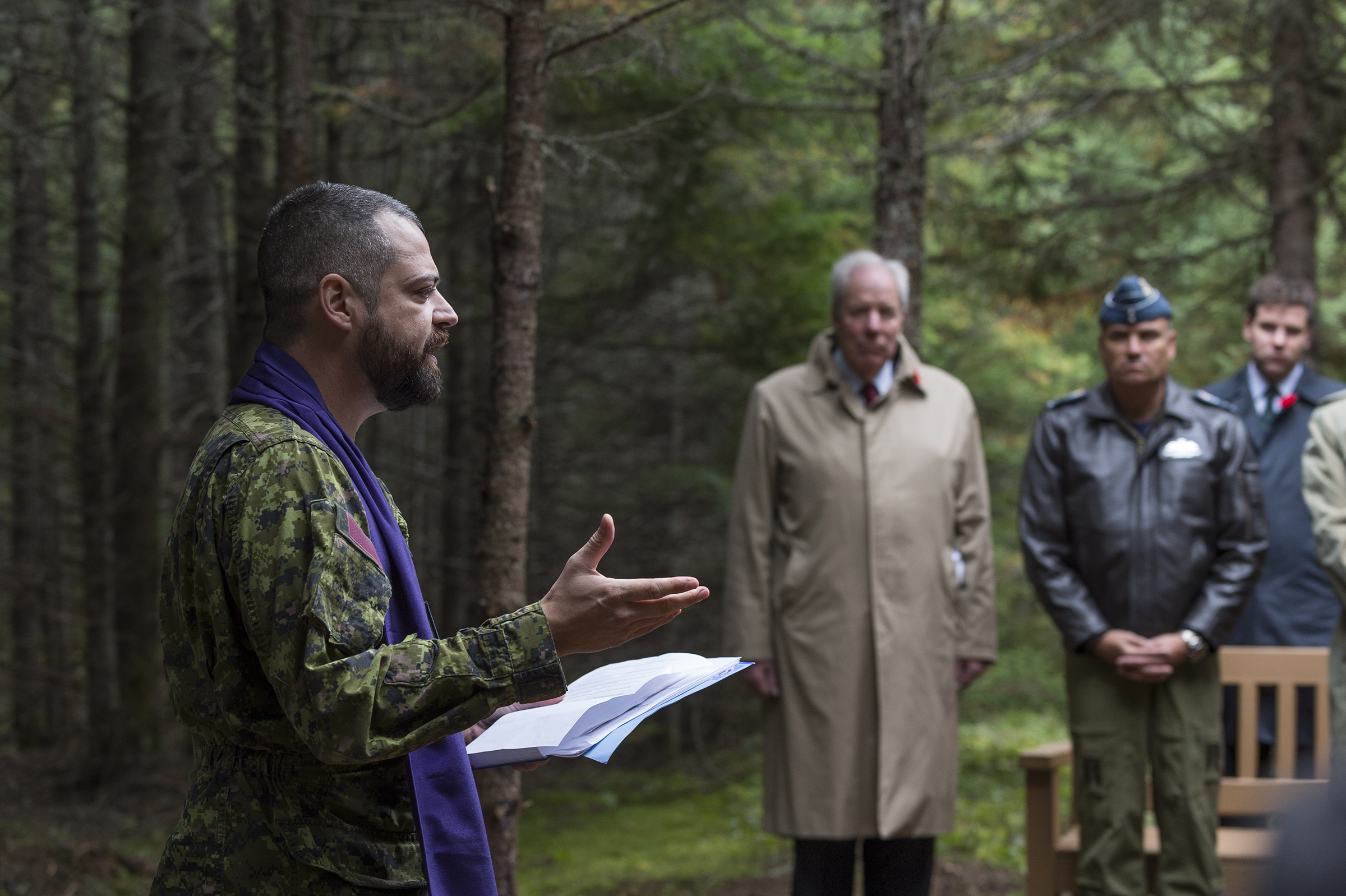 On September 14, 2019, Captain Jacques Tremblay, chaplain for 5 Canadian Division Support Group Gagetown, offers prayers during the unveiling of a monument commemorating the crash of Northrop Delta 673, which claimed the lives of Warrant Officer Class 2 James Edward Doan and Corporal David Alexander Rennie near Plaster Rock, New Brunswick, exactly 80 years before. PHOTO: Corporal Nicolas Alonso, GN02-2019-0949-010