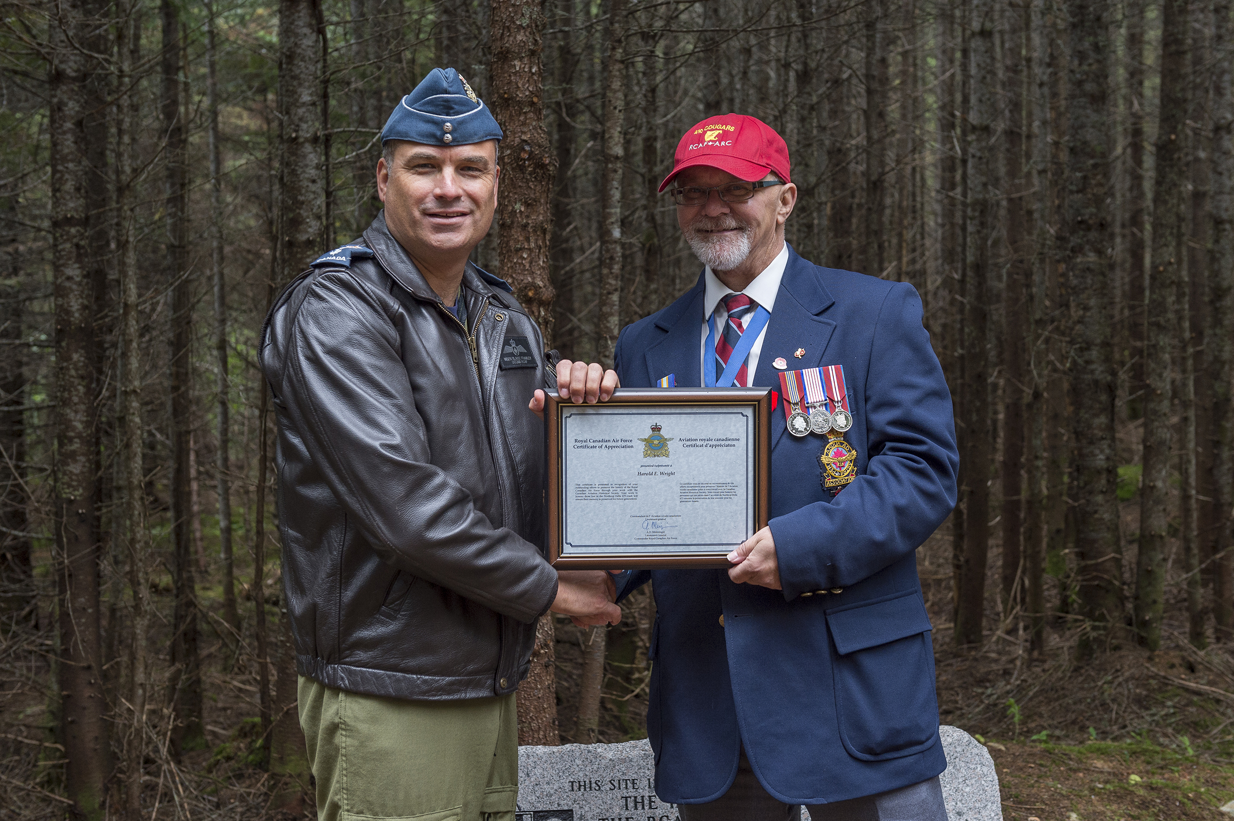 Major-General Blaise Frawley (left), presents a certificate of appreciation to Mr. Harold E. Wright of the Turnbull (N.B.) Chapter of the Canadian Aviation Historical Society during the ceremony commemorating Warrant Officer Class 2 James Edward Doan and Corporal David Alexander Rennie who died on September 14, 1939, when their Northrop Delta aircraft crashed near Plaster Rock, New Brunswick. PHOTO: Corporal Nicolas Alonso, GN02-2019-0949-021