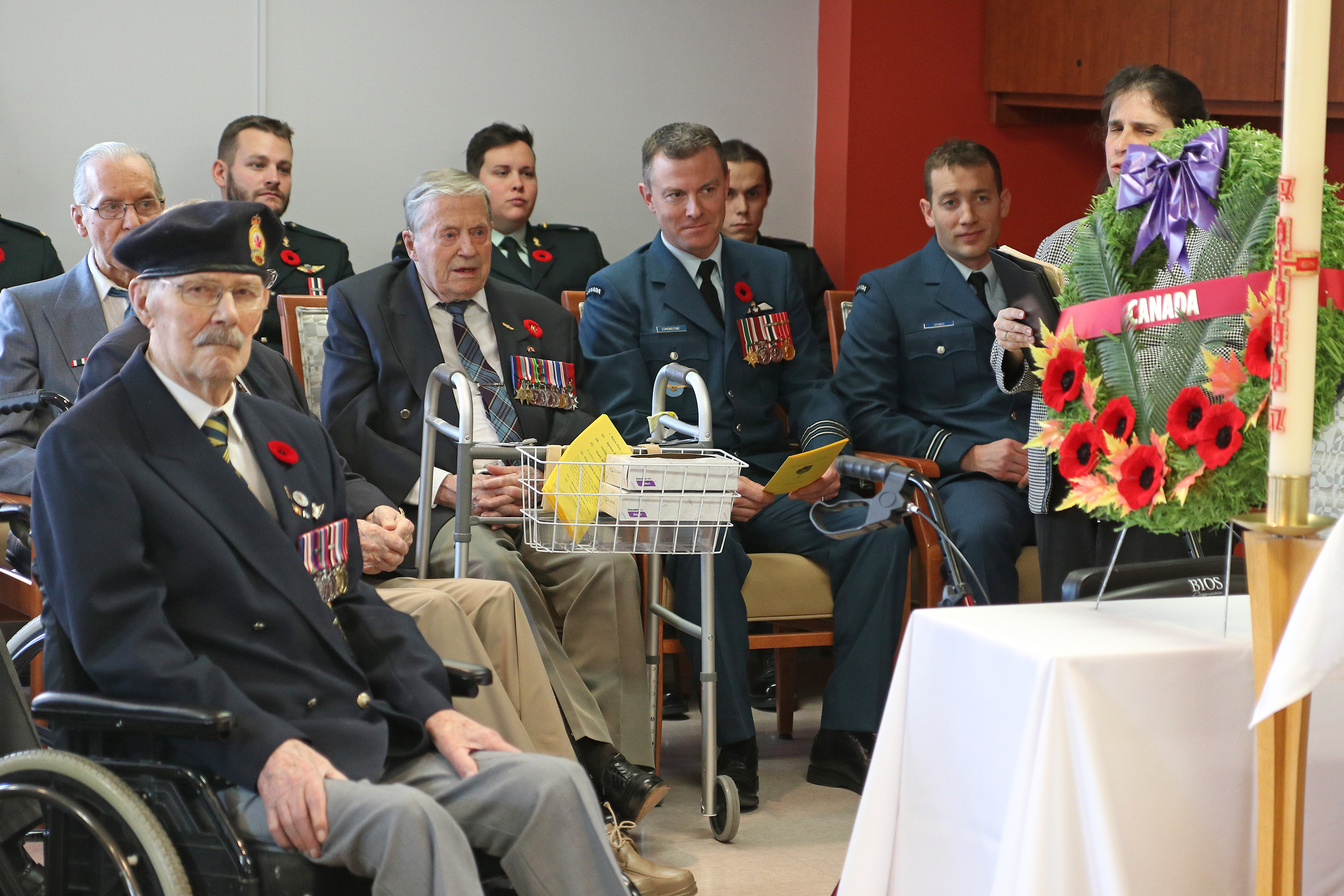 From left, Flight Sergeant (retired) Jean Cauchy, Lieutenant-Colonel Jody Edmonstone and Captain Matt Stokes listen attentively during a 2019 Remembrance Day ceremony at Maison Paul Triquet where Flight Sergeant Cauchy lives in Quebec City. PHOTO: Submitted