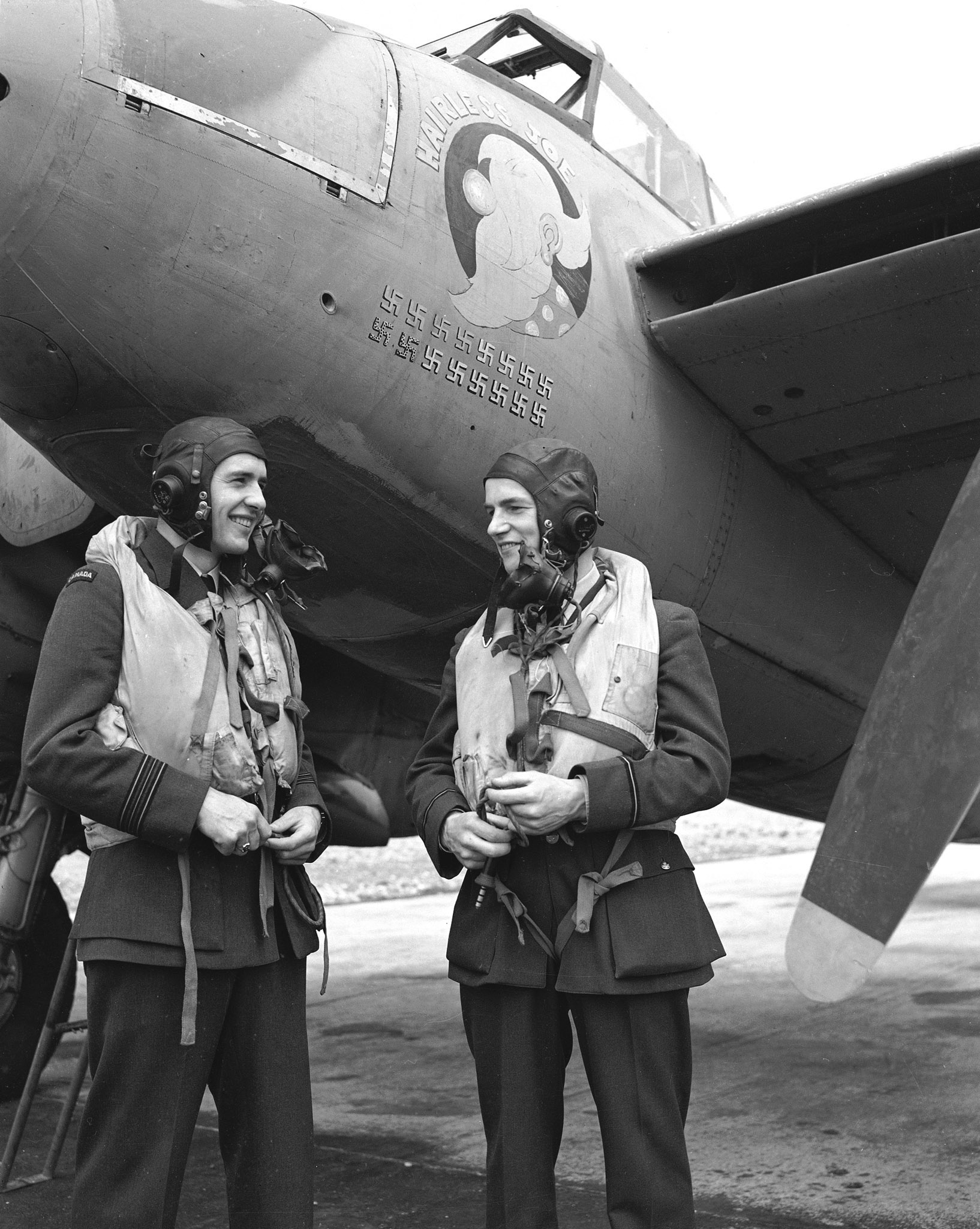 Squadron Leader Russell Bannock (left) of the Royal Canadian Air Force and Flying Officer Robert Bruce of the Royal Air Force, in an undated photograph. PHOTO: DND Archives, PL-31295