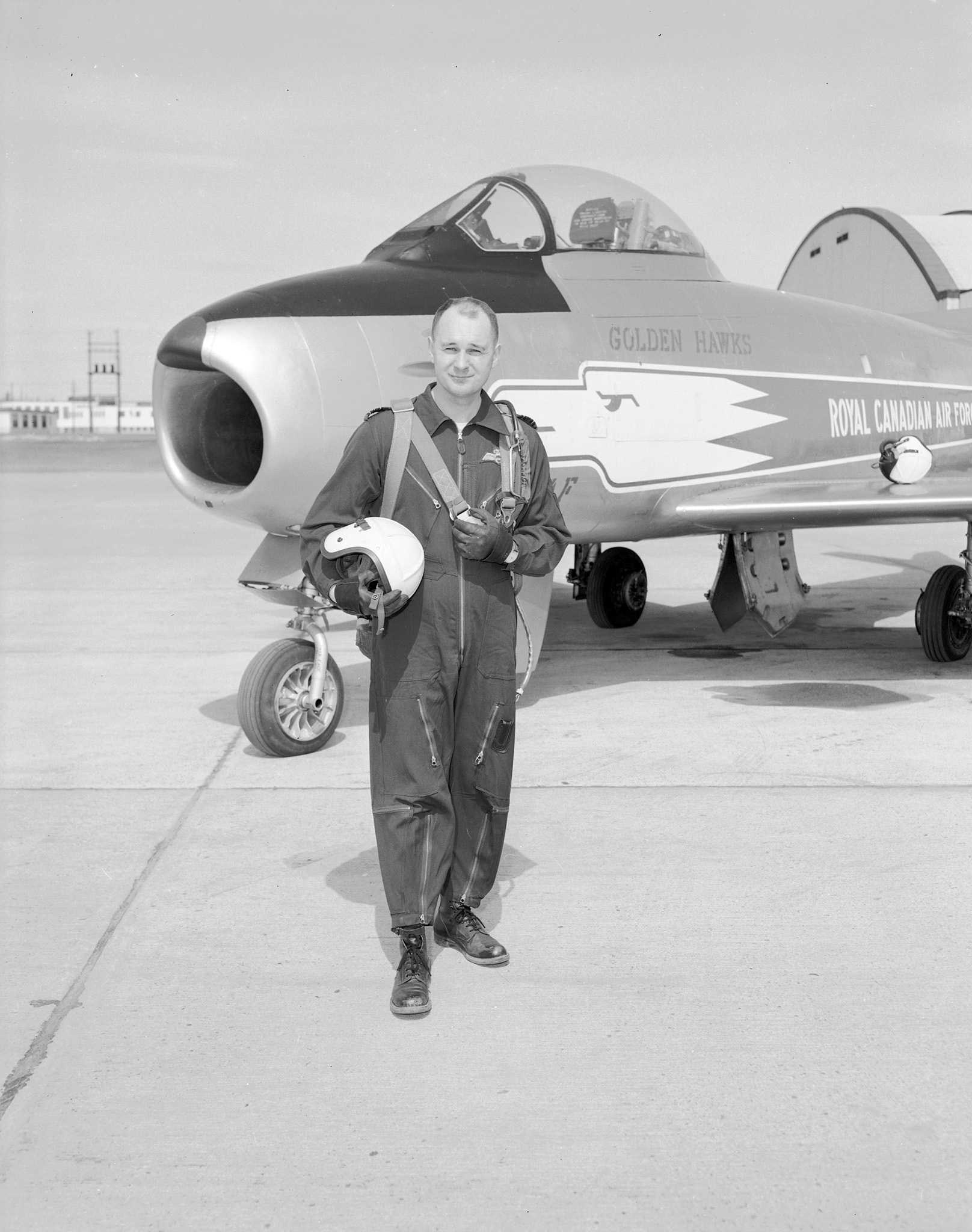 Squadron Leader Fern Villeneuve, leader of the Golden Hawks, walks away from his F-36 Sabre after a formation practice. PHOTO: DND Archives, PL 64157
