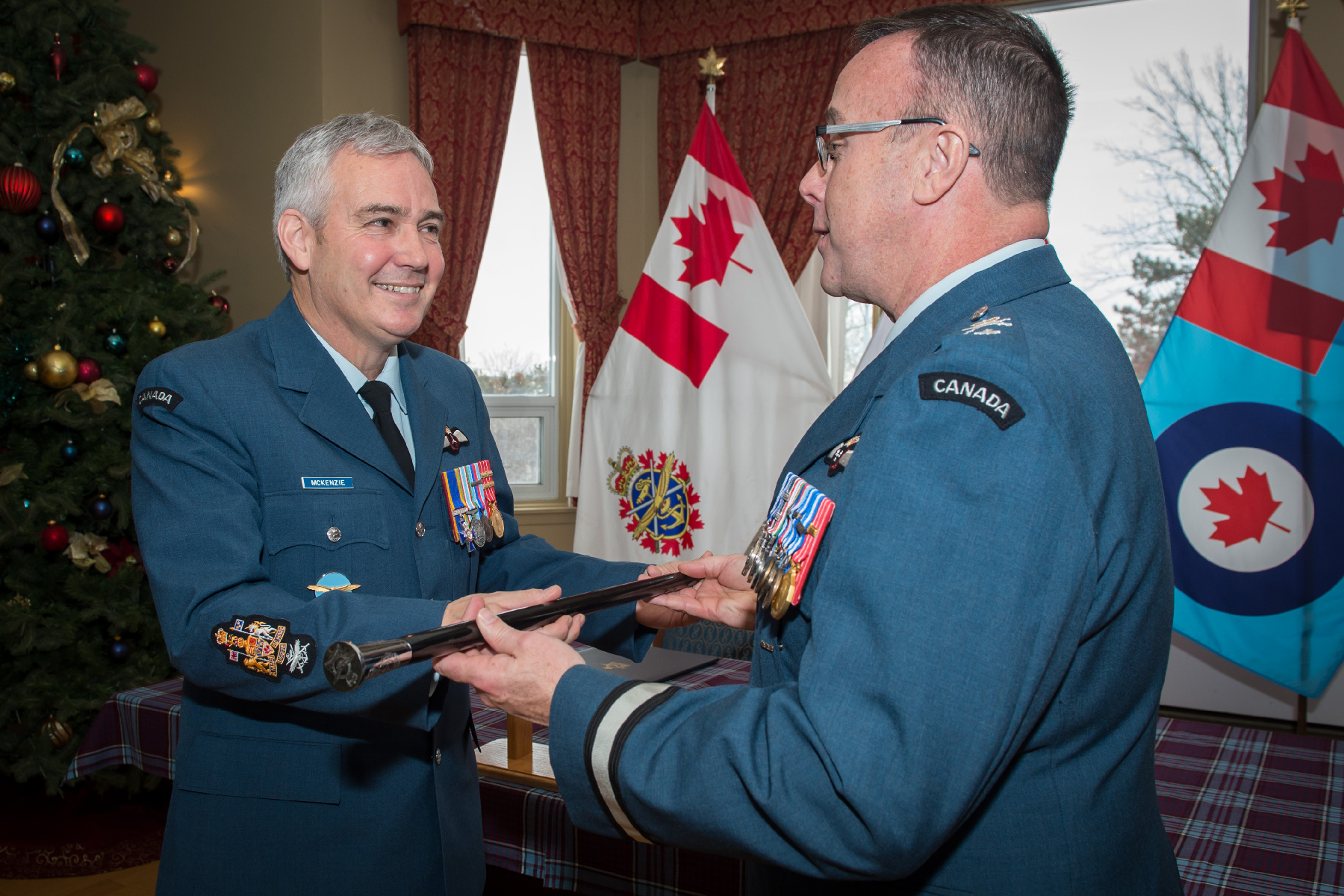 Brigadier-General Michael Rafter (right), Director General Air Reserve, presents to Chief Warrant Officer Jim McKenzie the RCAF Reserve Chief Warrant Officer pace stick. Traditionally, the pace stick is used in ceremonial drill and, as a symbol, represents the bearer's appointment and authority. PHOTO: Corporal Kenneth Beliwicz