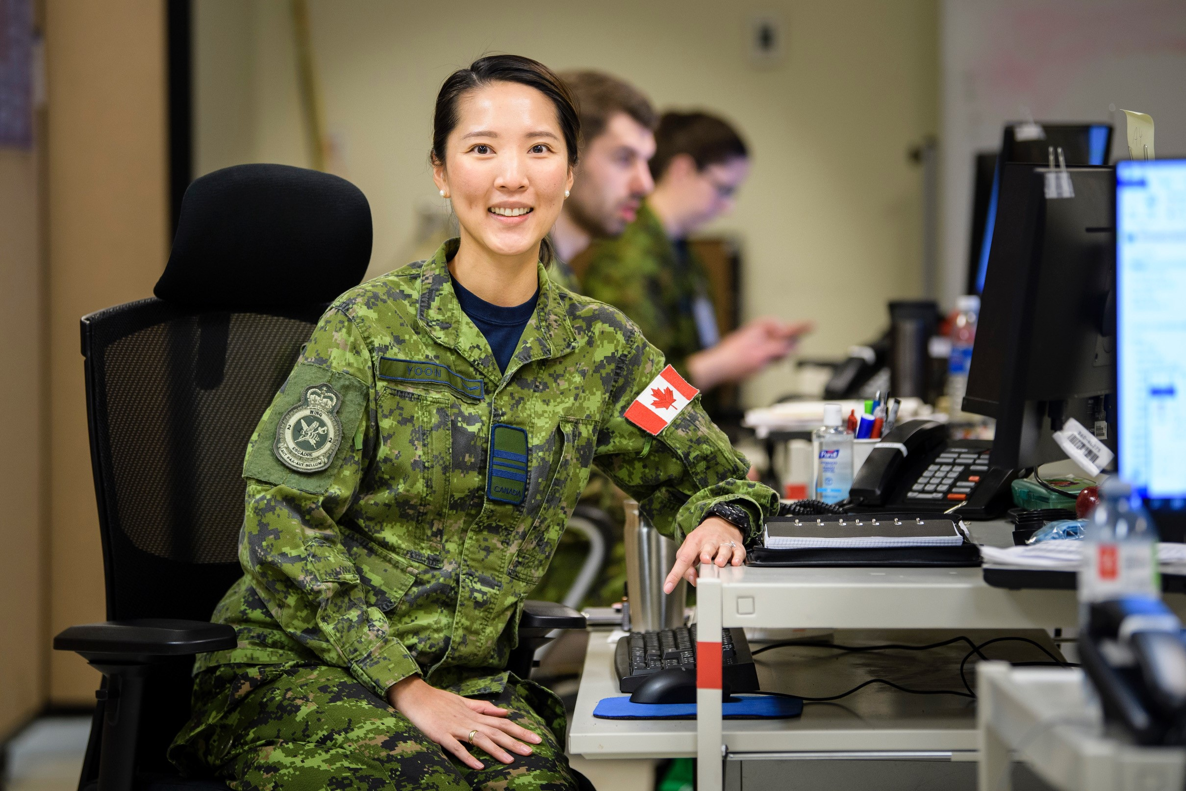 Major Jane Yoon, Operation LASER Air Task Force Logistics Officer, pictured here with her colleagues at the team's headquarters in Kingston, Ontario, on April 22, 2020. PHOTO: Steve McQuaid