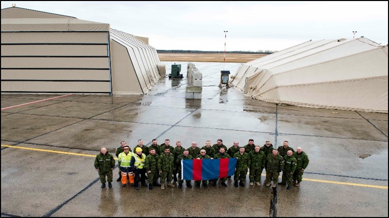 Members of 4 Wing Cold Lake, Alberta, stand in front of a newly assembled Expeditionary Forces Aircraft Shelter System and a Mobile Support Shelter – Aircraft, in the fall of 2019. PHOTO: Submitted