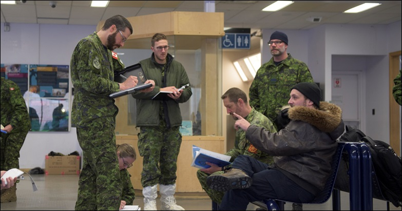 Reconnaissance team members from 2 Air Expeditionary Wing interview the Rankin Inlet Airport manager during their survey visit to Rankin Inlet on January 28, 2020. PHOTO: Submitted