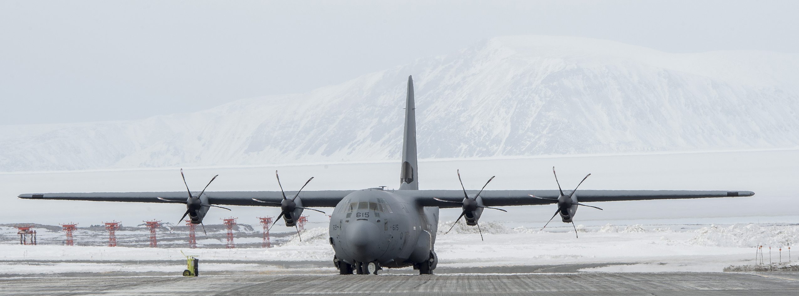 A CC-130 Hercules parks on the flight line in Thule, Greenland, waiting for its next flight out to Alert during Operation Boxtop on April 27, 2017. PHOTO: Corporal Audrey Solomon
