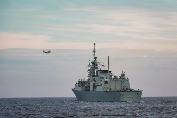 Overflying Royal Canadian Navy frigate HMCS Ville de Québec in August 2020, an RCAF CP-140 Aurora aircraft patrols the sky during Operation Nanook. PHOTO: Op Nanook