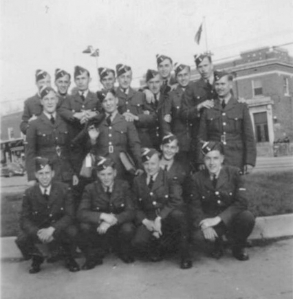 A photograph of Course 31 (June 21–August 30, 1941) at No. 9 Service Flying Training School at RCAF Station Summerside, Prince Edward Island. As they still wear their white cadet hat flashes, it's clear this photo was taken before their graduation. Lewis Burpee stands at far right.  PHOTO: Via the Canadian Virtual War Memorial