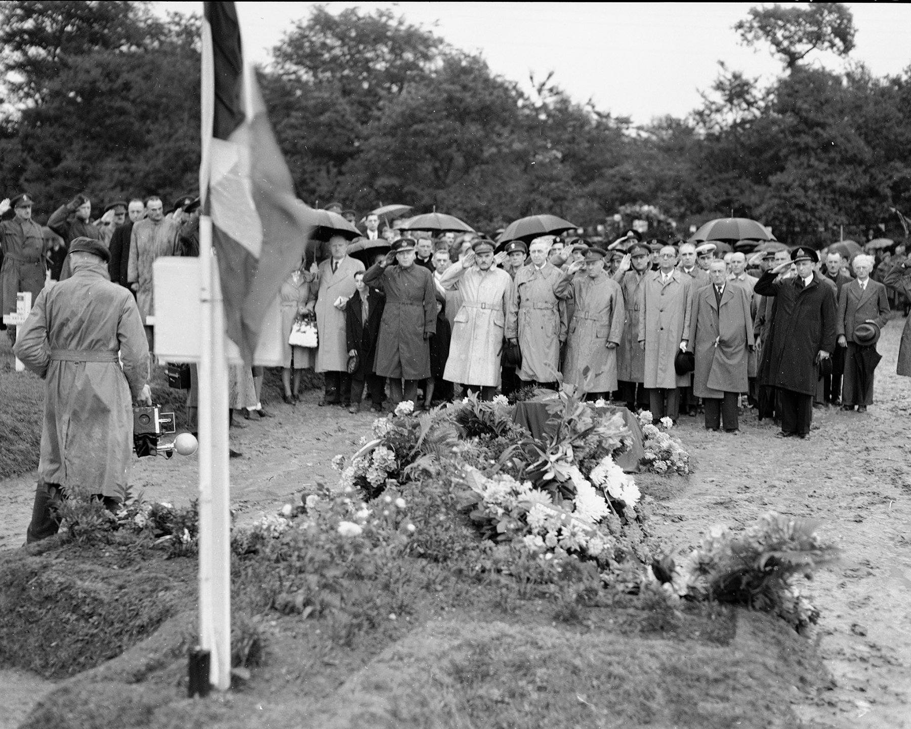 """Last Post"" sounds through the Canadian cemetery in Dieppe, France, on August 19, 1945, during the ceremony marking the third anniversary of the August 1942 Dieppe raid by the Second Canadian Division. DND Archives, PL-45590"