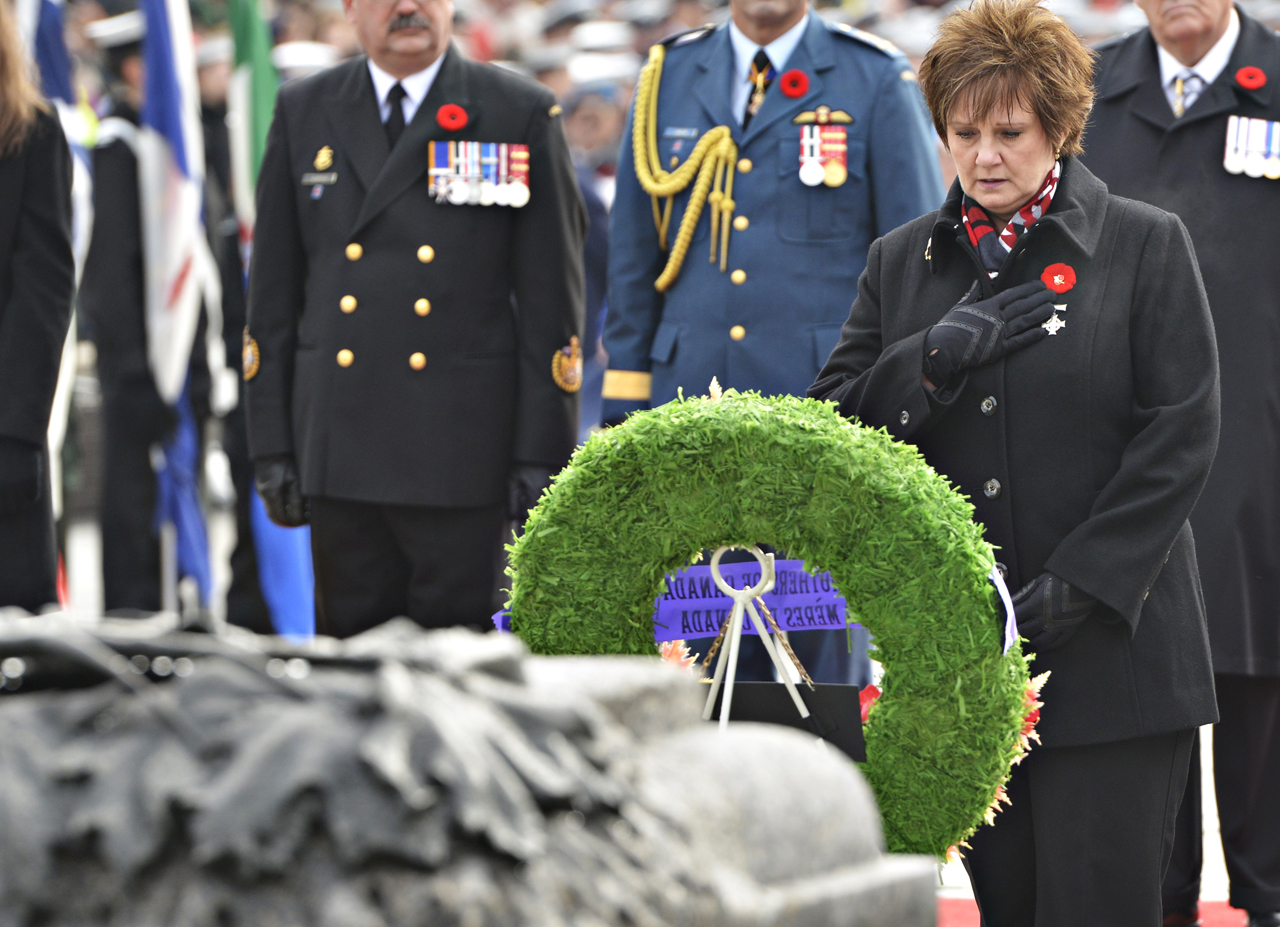 National Memorial (Silver) Cross Mother Roxanne Marie Priede, takes a moment to reflect after laying a wreath in memory of her son Master Corporal Darrell Jason Priede, during the Remembrance Day ceremonies at the National War Memorial in Ottawa, Sunday, November 11, 2012. PHOTO: iPolitics/Matthew Usherwood