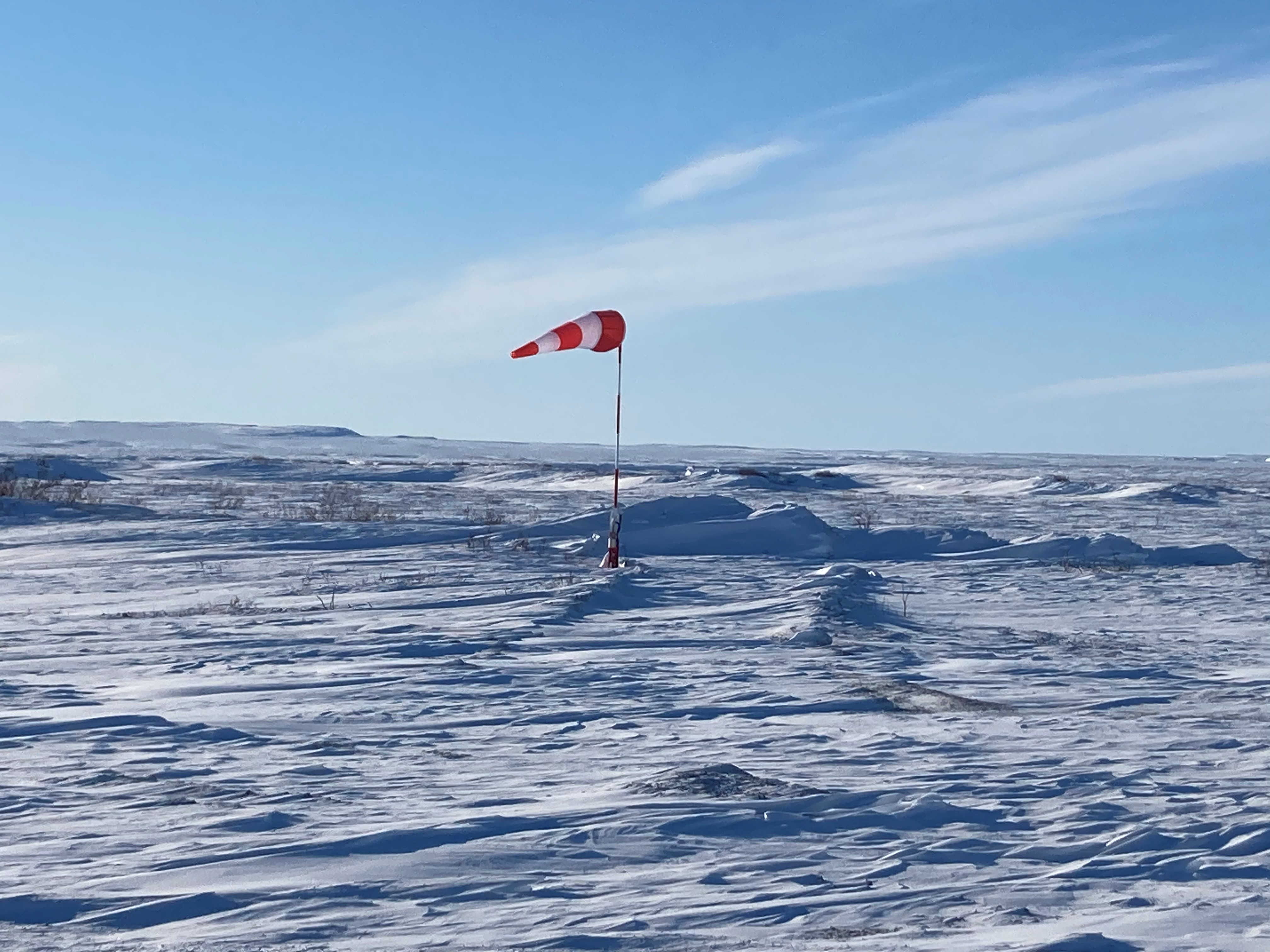 A windsock in the hamlet of Kugluktuk, Nunavut, shows strong winds while the reconnaissance team conducts airfield infrastructure assessments on March 10, 2021. PHOTO: Captain Esteban Simard