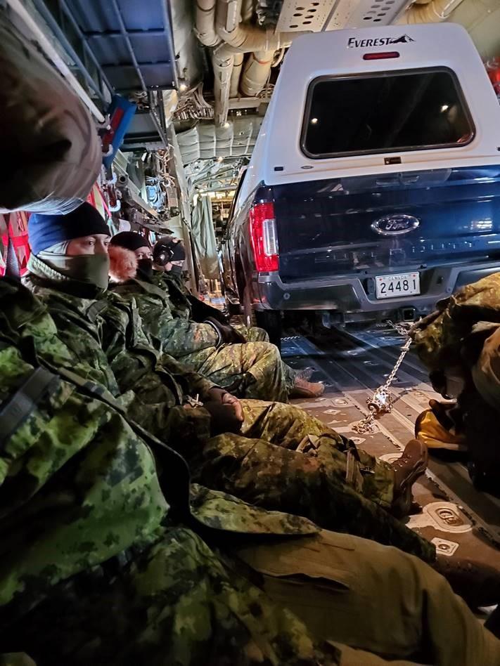 Members of the aerodrome reconnaissance team transit from Yellowknife, Northwest Territories, to Coral Harbour, Nunavut, on board a Royal Canadian Air Force CC-130 Hercules aircraft during airfield infrastructure assessments conducted between March 3 and 12, 2021. PHOTO: Captain Alexandre Marcil