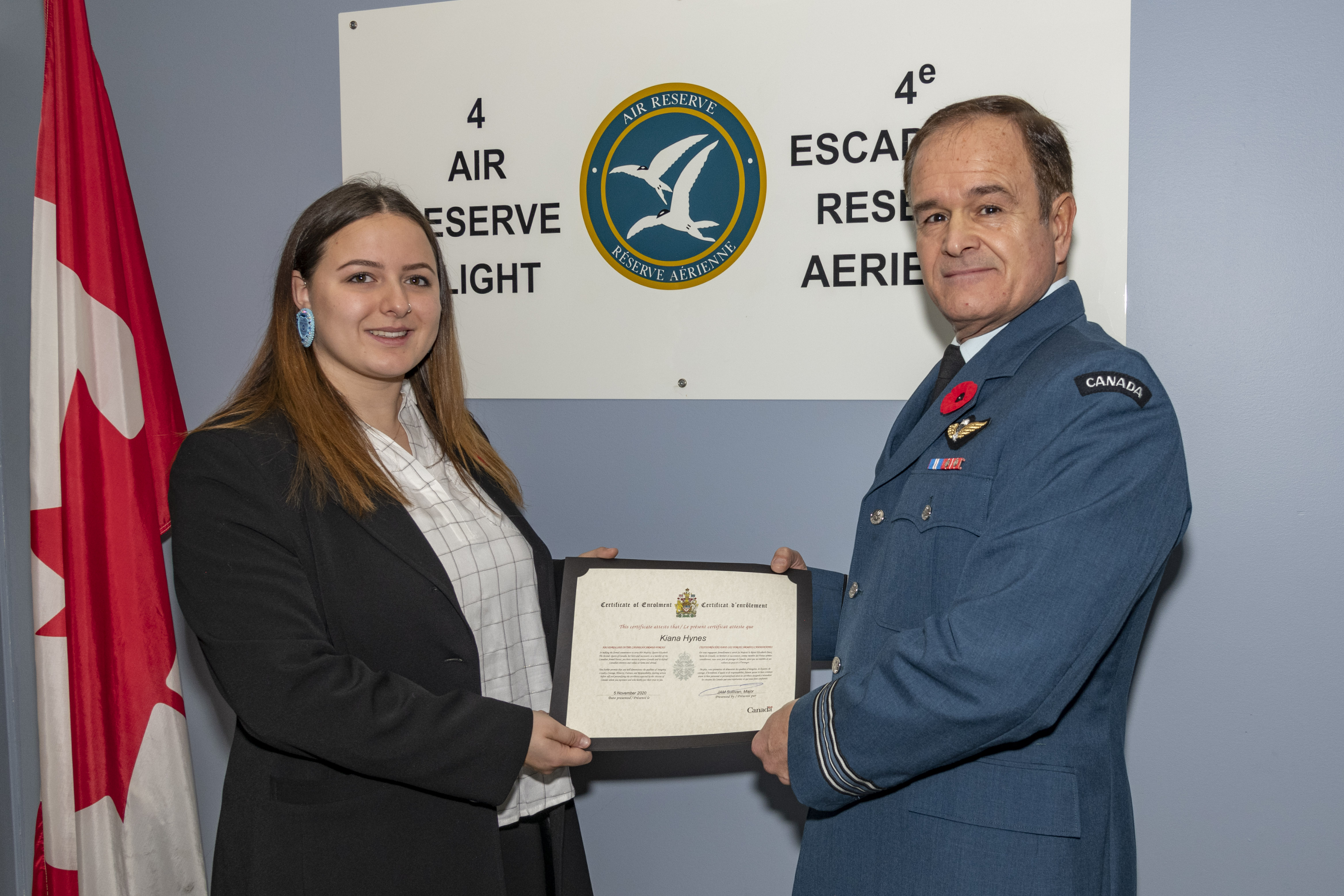 Aviator Kiana Hynes was enrolled in the RCAF Reserve at 4 Wing with Major John Sullivan, 4 Wing Air Reserve Flight Commander (at right).