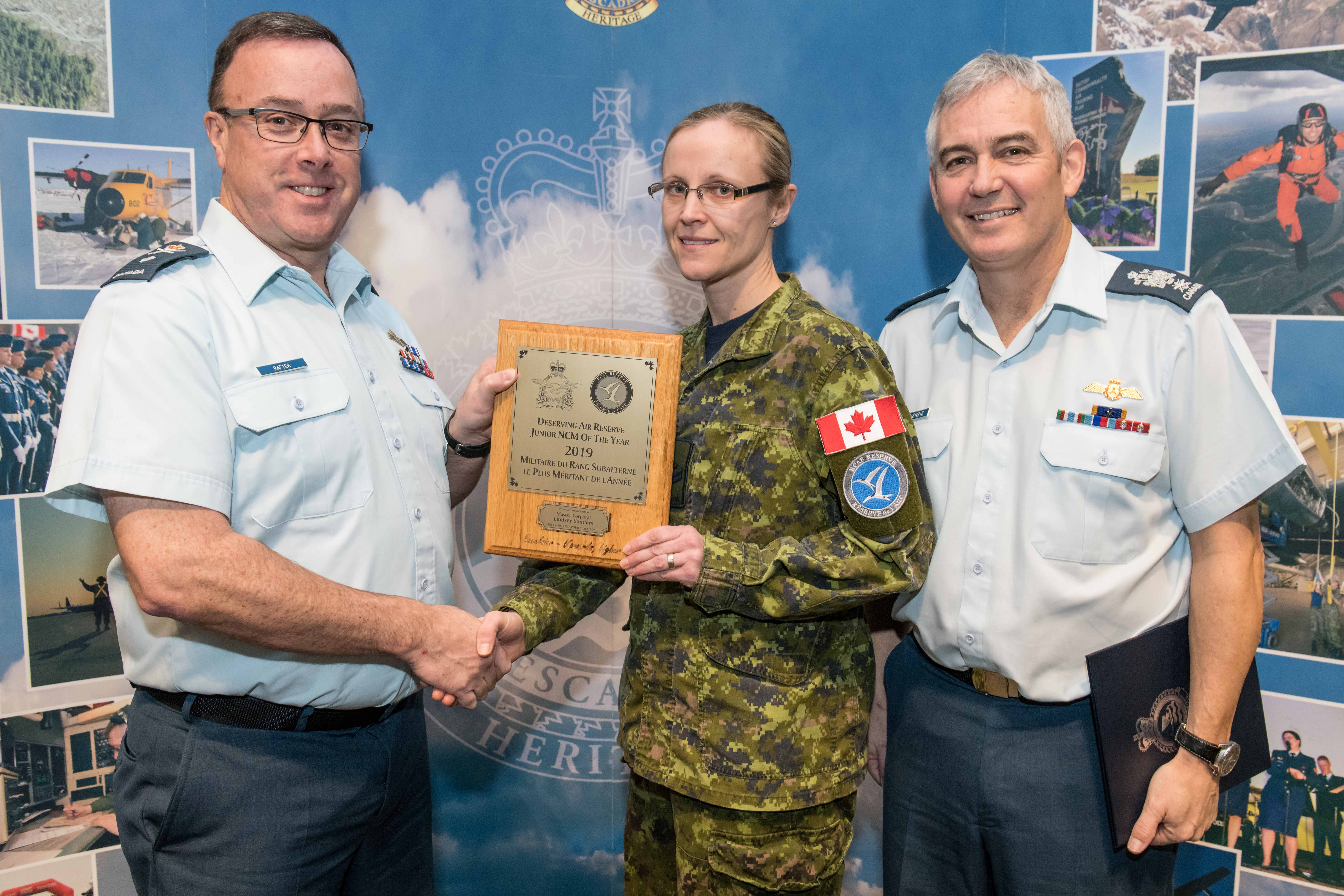 Master Corporal Lindsey Sanders is presented the 2019 RCAF Reserve Junior NCM of the Year Award
