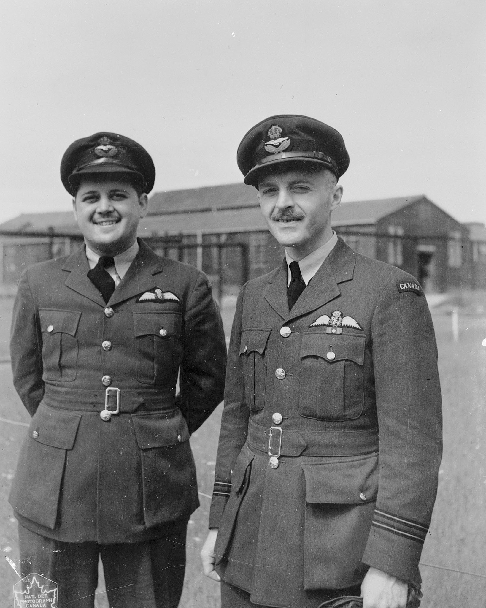 "Two captains of the Canso flying boats operating with 162 Squadron against German submarines in the North Atlantic: (left) Flying Officer Bernard ""Denny"" Denomy of Chatham, Ontario, and Flight Lieutenant Dave Hornell of Mimico, Ontario. Flight Lieutenant Hornell was awarded the Victoria Cross posthumously for his gallantry when his Canso crashed in the North Atlantic. Flying Officer Denomy was his co-pilot. PHOTO: DND Archives, PL-30823"