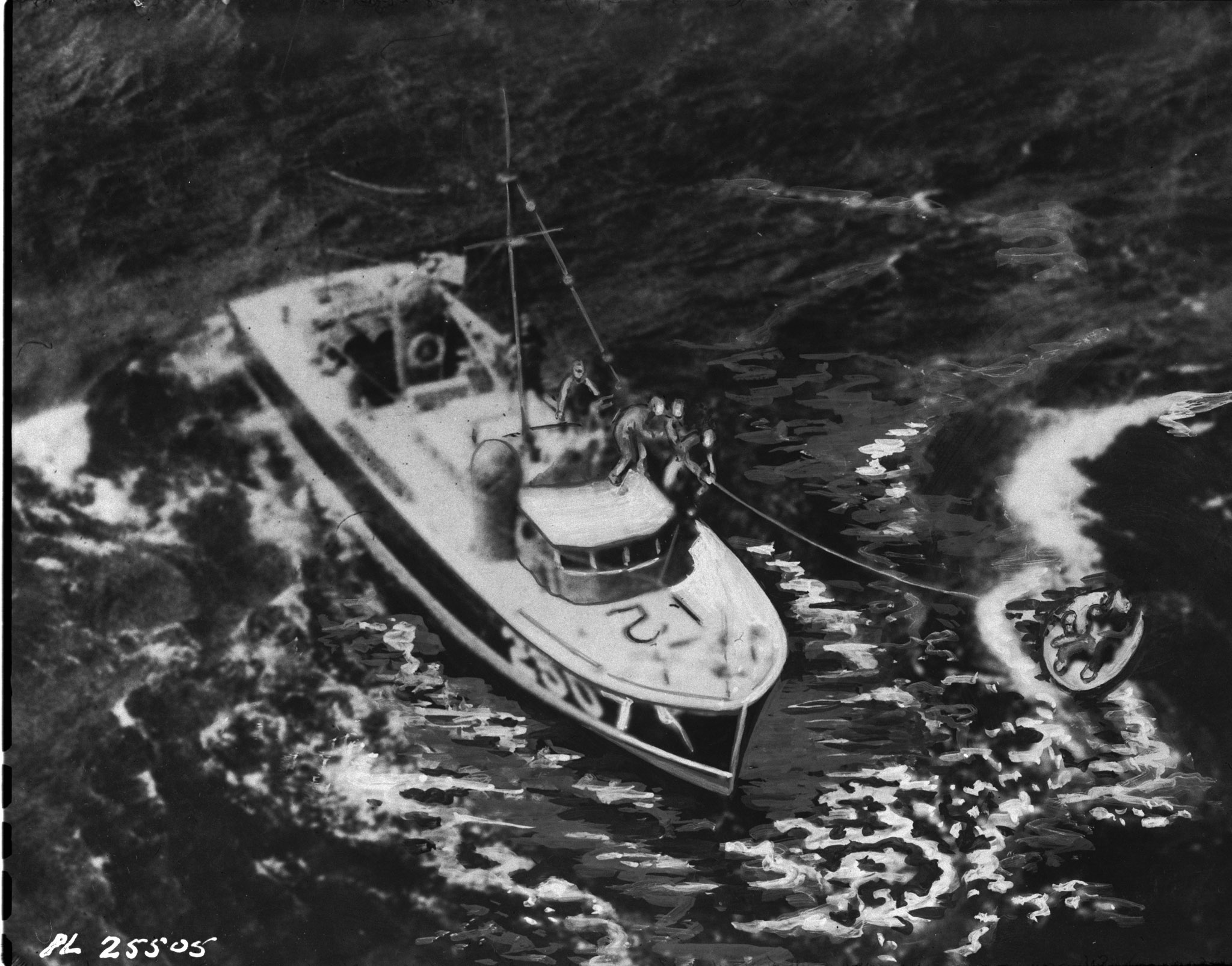 "This retouched photograph shows an air-sea-rescue launch hauling to safety survivors of the Royal Canadian Air Force Canso ""C for Charlie"" who spent 21 hours in the stormy North Atlantic after sinking a German submarine. Badly damaged by the subs guns, the burning plane, piloted by Flight Lieutenant David Hornell was forced into the sea. The crew of eight could not crowd into the one serviceable rubber dinghy and took turns clinging to the side. Sergeant Donald Scott and Sergeant Fernand St. Laurent died of exposure before help came. Flight Lieutenant Hornell died a few minutes after this picture was taken and was posthumously awarded the Victoria Cross. Other members of the crew, all of whom were honoured for their heroic exploit were Flying Officer Bernard Denomy, Flying Officer Graham Campbell, Flying Officer Sidney E. Matheson, Flight Sergeant Israel J. Bodnoff and Flight Sergeant Sidney Cole. PHOTO: DND Archives, PL-25505"