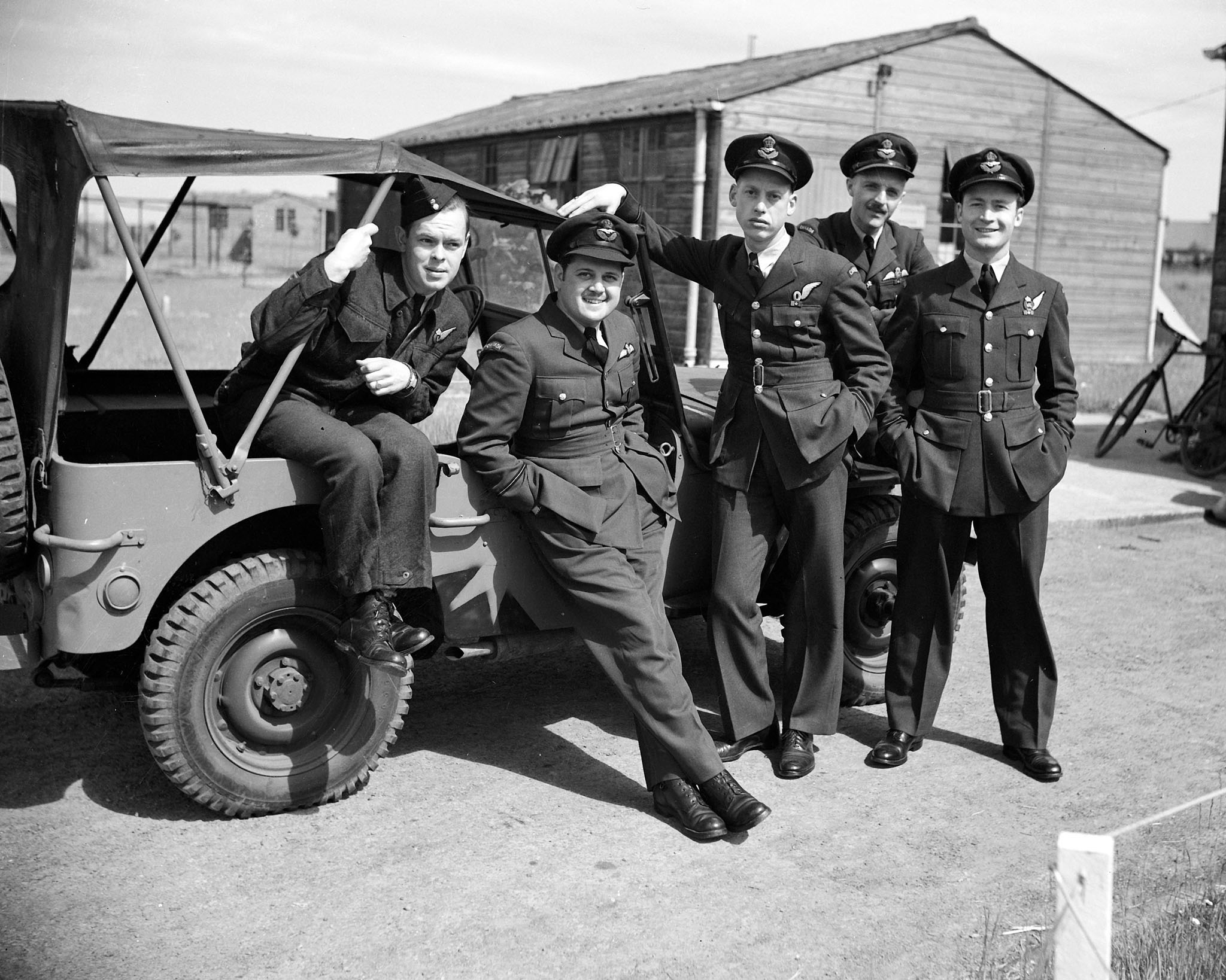 "Some of the crew of a Canadian Canso flying boat ""C for Charlie"", photographed in Iceland before setting out on anti-submarine patrol in the North Atlantic on January 22, 1944. From left to right: Sergeant Donald Scott, Packenham, Ontario; Flying Officer Bernard Denomy, Chatham, Ontario; Flying Officer Sydney Matheson, Nelson, British Columbia; Flight Lieutenant David Hornell, Mimico, Ontario; and Flying Officer Graham Campbell, Vancouver, British Columbia. PHOTO: DND Archives, PL-30826"